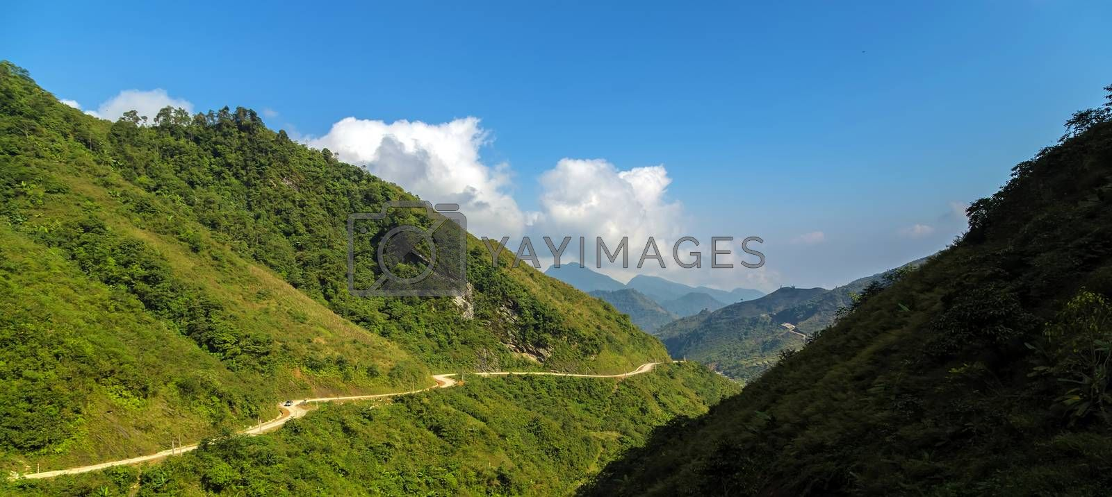 Curved way countryside mountains landscape summer with cloudy sky country road