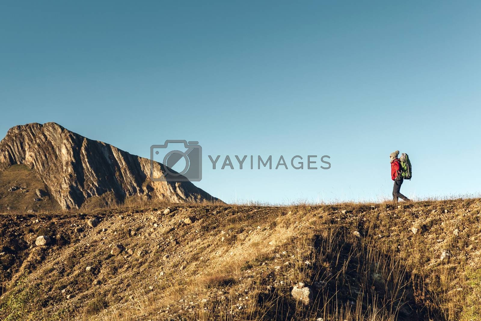 Shot of a woman exploring the montains with a backpack