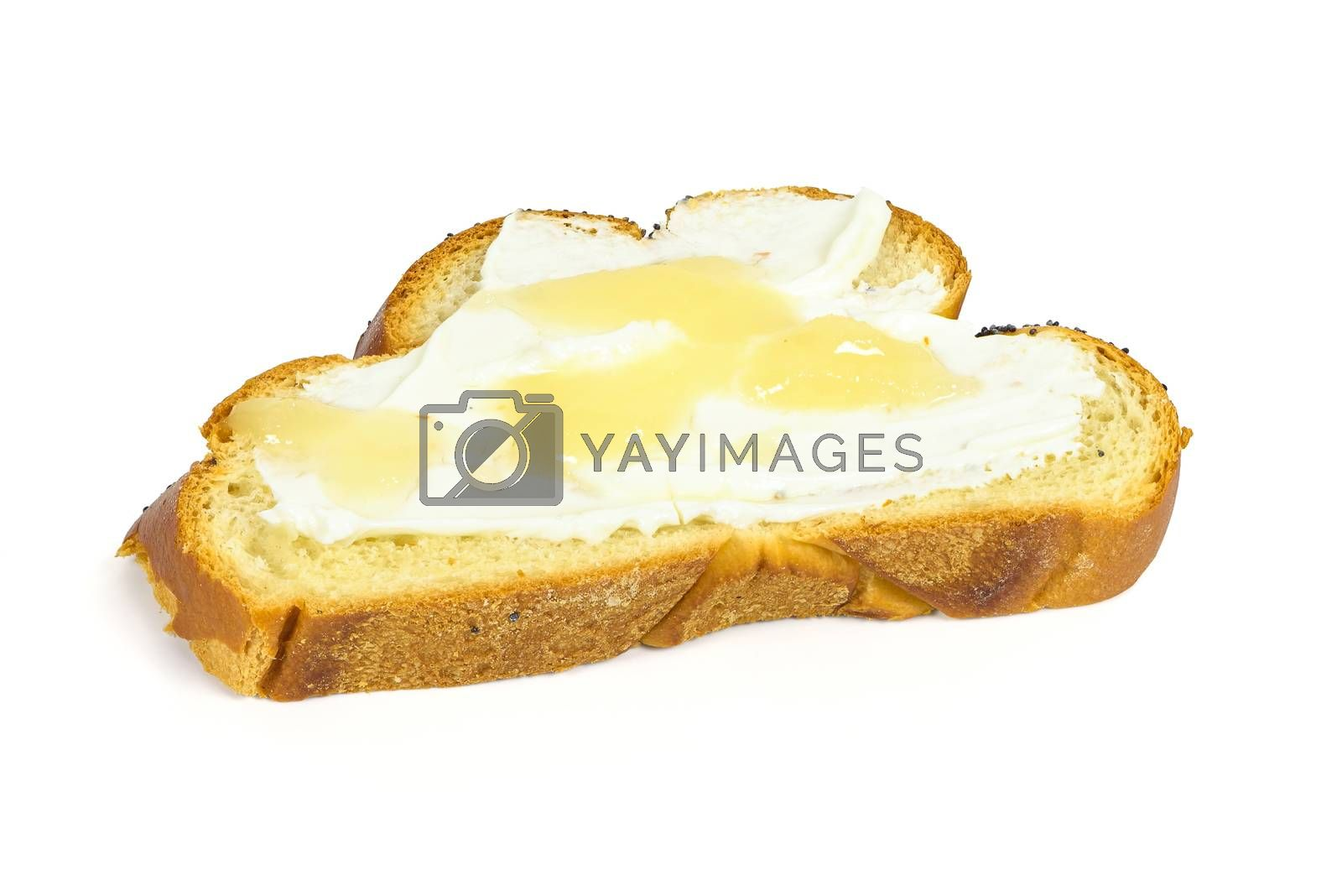 Slice of challah bread with cottage cheese and honey isolated on white background with clipping path