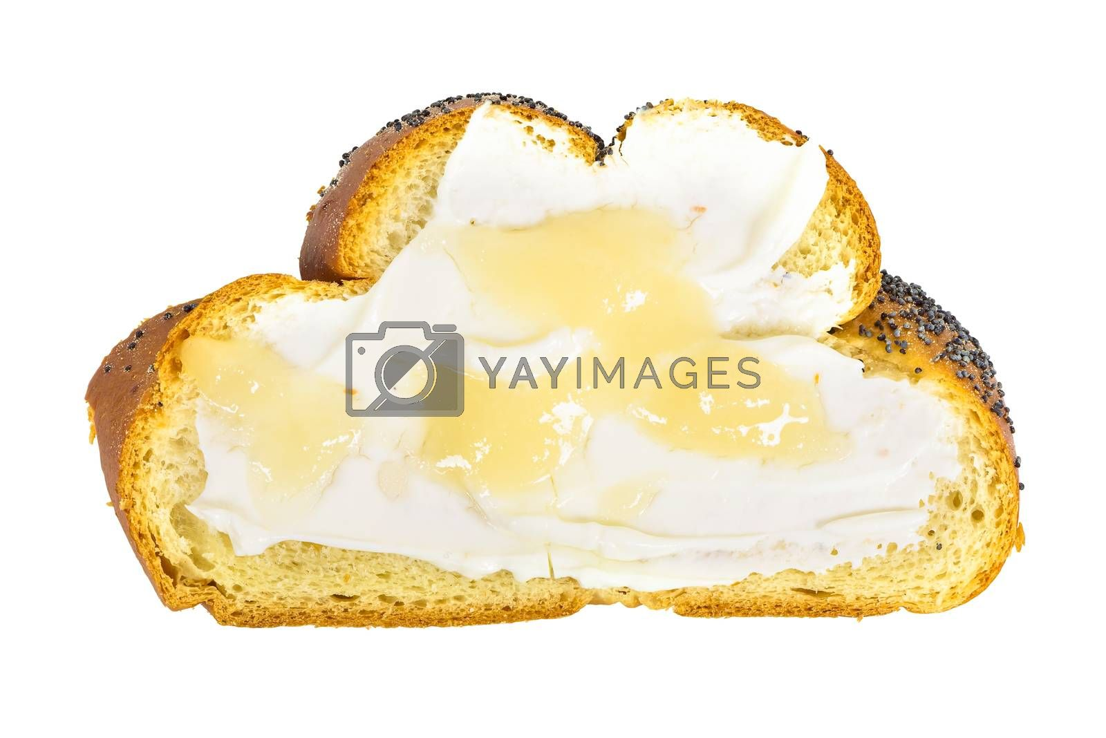 Top view of slice of challah bread with cottage cheese and honey isolated on white background with clipping path