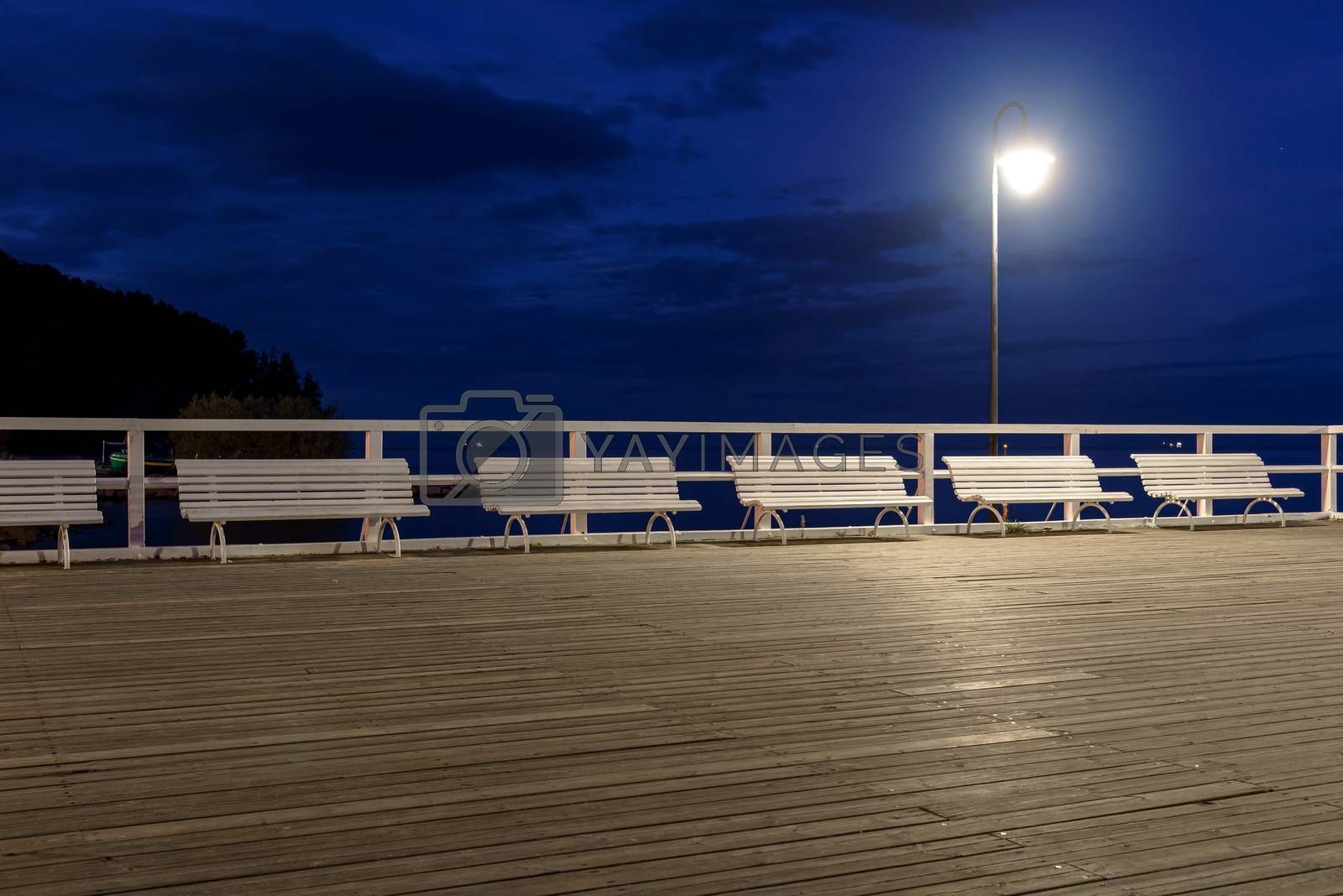 Night view of the benches on the pier in Gdynia Orlowo in Poland