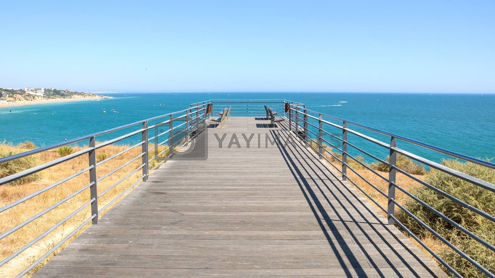 Benches on the terrace at the Atlantic ocean in Albufeira, Algarve, Portugal