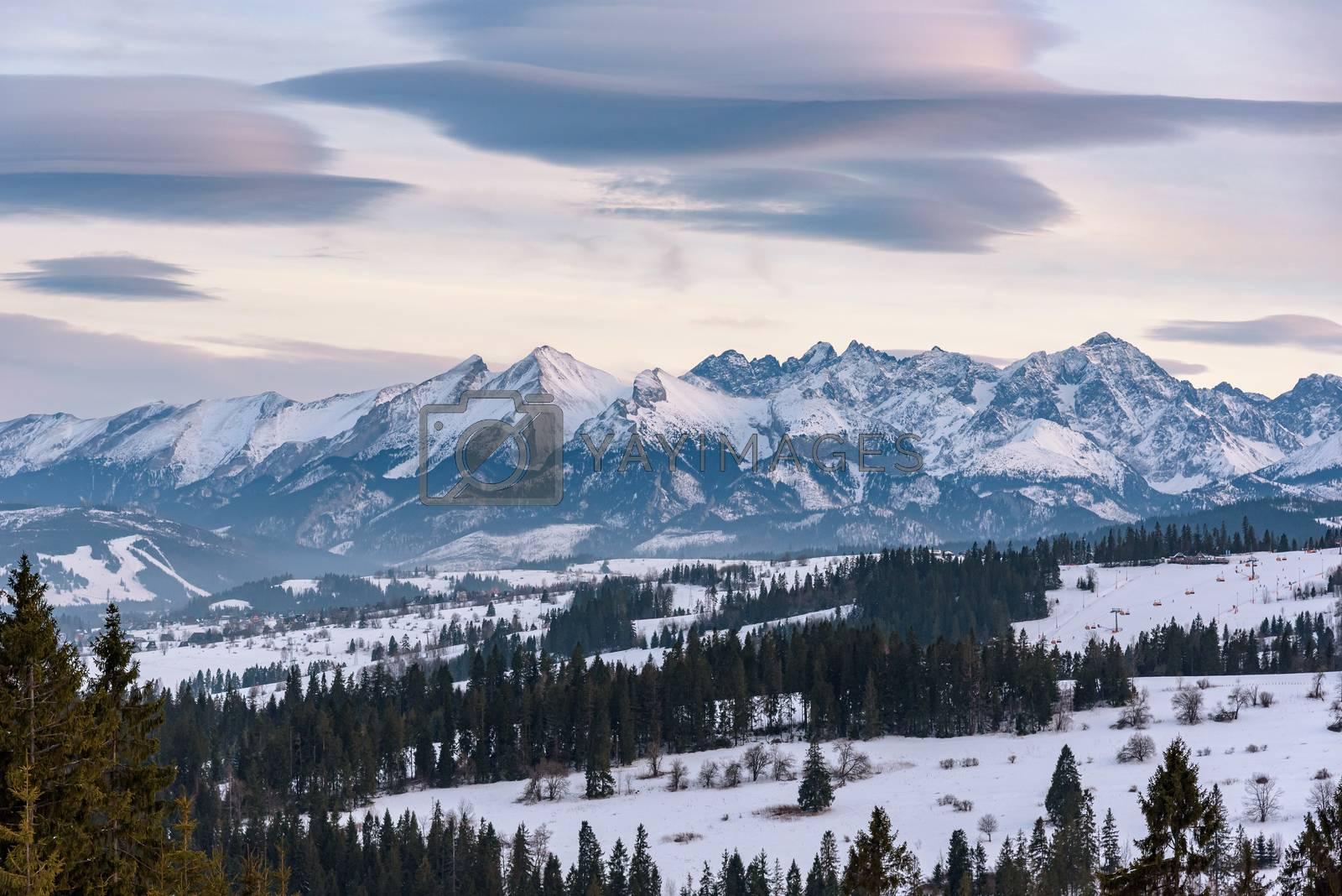 Winter landscape of High Tatra Mountains on the Polish-Slovak border at dusk