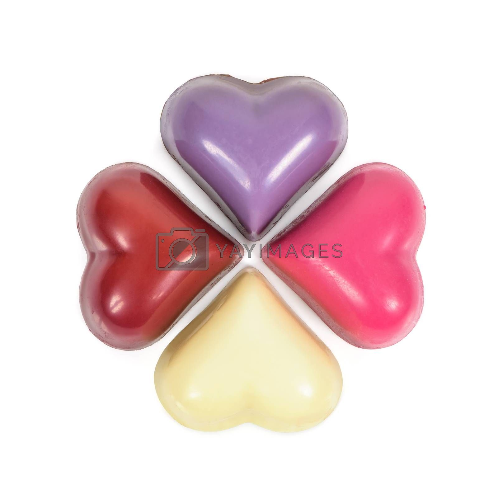 Colorful heart shaped chocolates isolated on white background with clipping path
