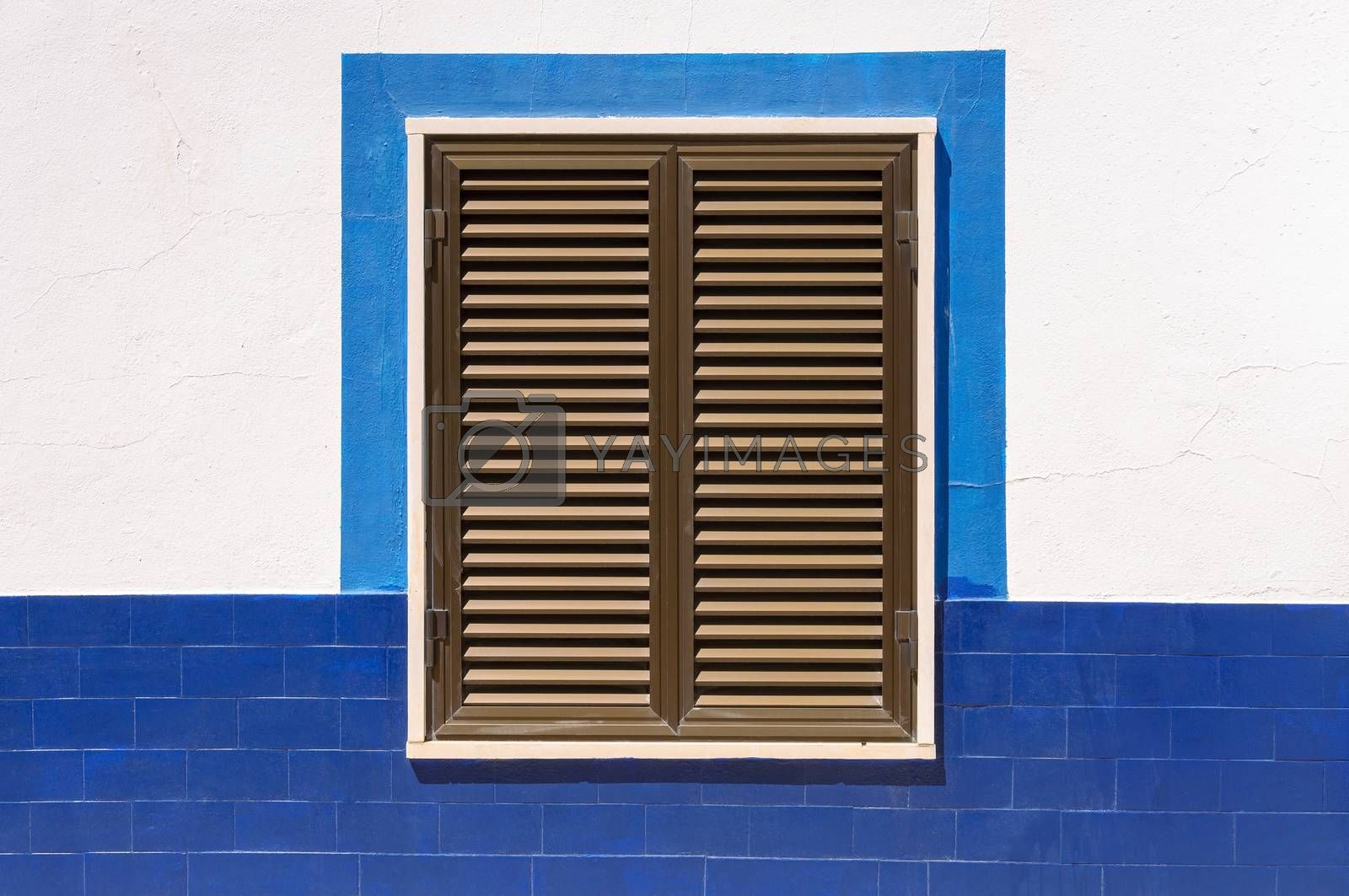 Royalty free image of Closed window shutters of an mediterranean house by mkos83
