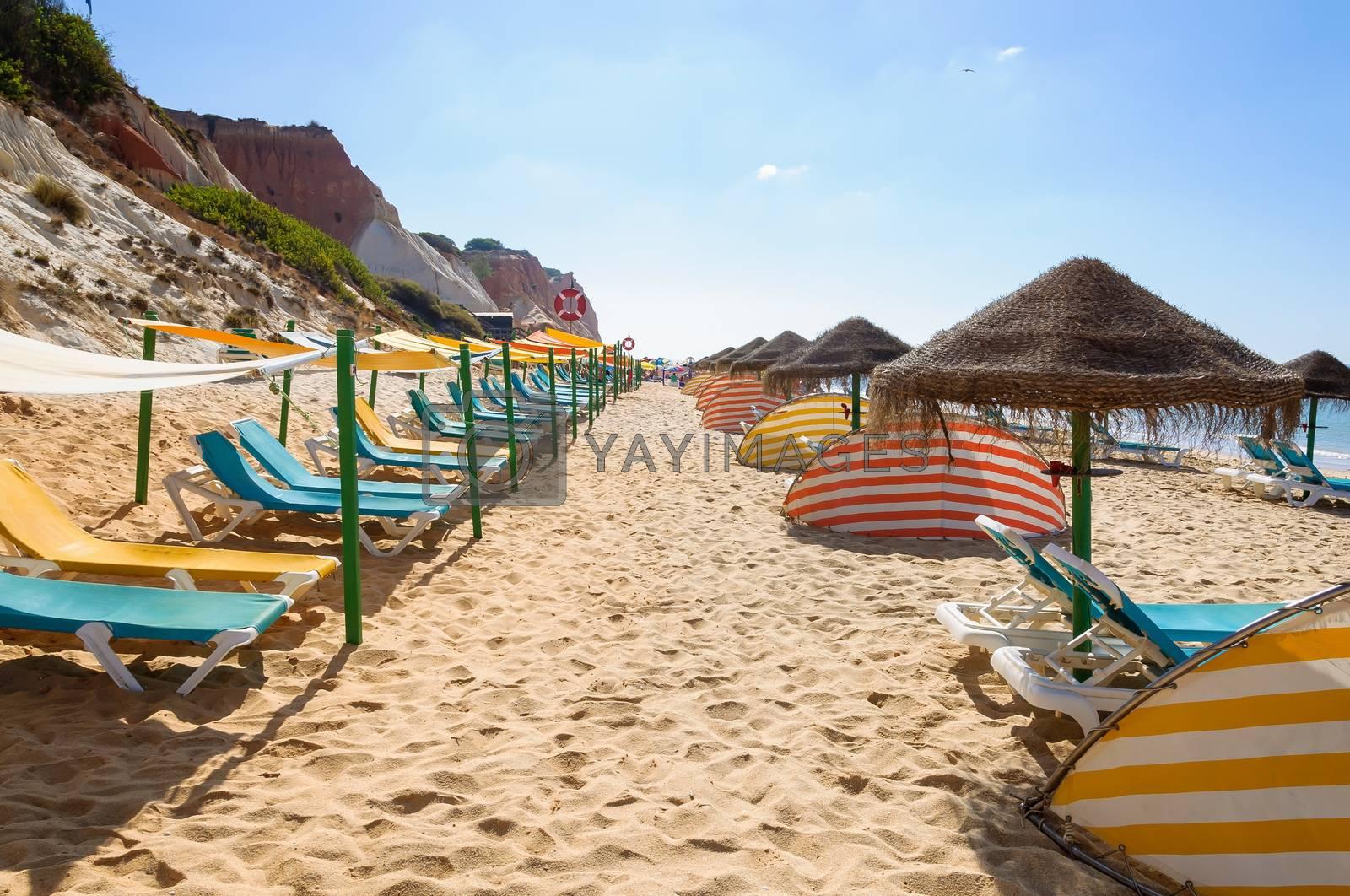 Sunbeds and umbrellas on Falesia Beach, Algarve, Portugal