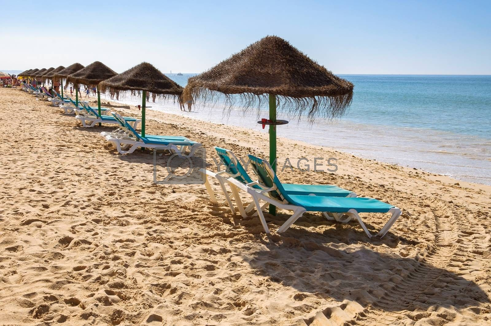 Royalty free image of Sunbeds and umbrellas on Falesia Beach by mkos83