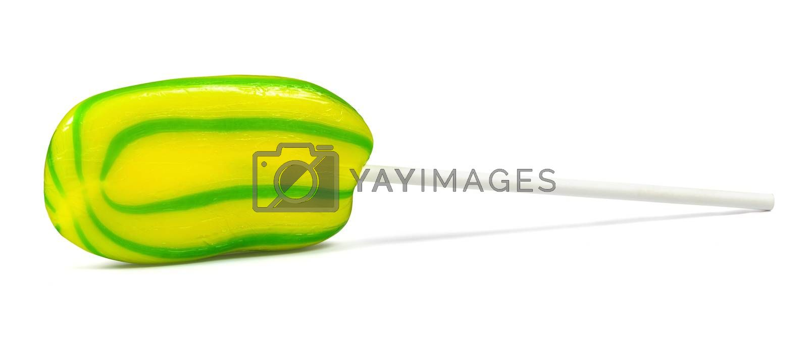Royalty free image of Yellow-green lollipop on white background by mkos83