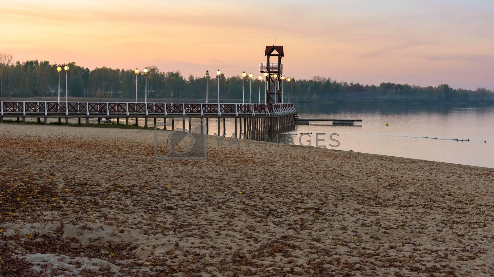 Evening autumn view of beach and pier at Pogoria III lake in Dabrowa Gornicza, Poland