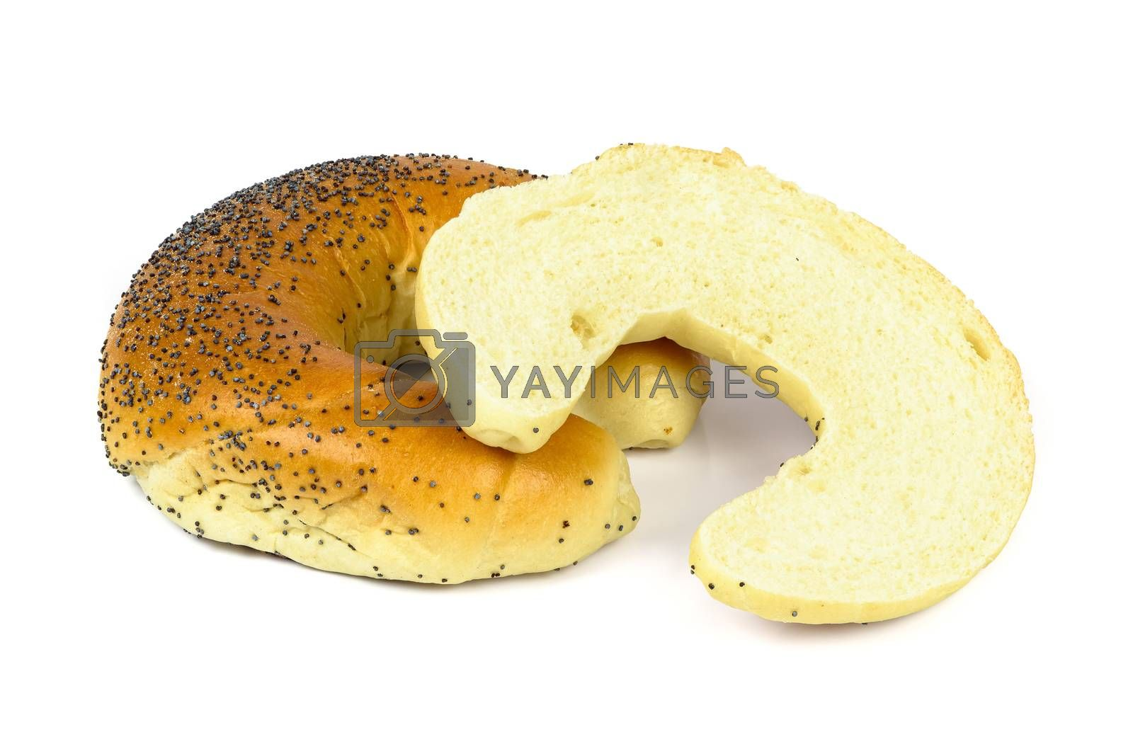 Cut crescent roll with poppy seeds isolated on white background with clipping path