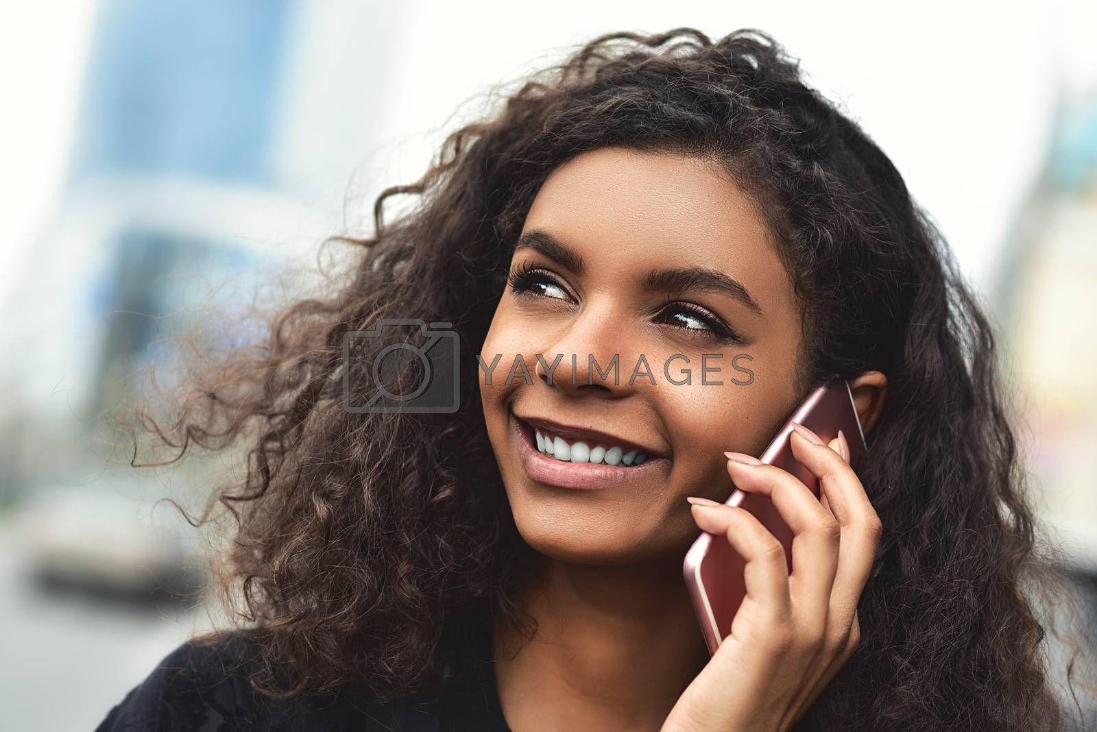 Happy beautiful woman walking and writing or reading sms messages