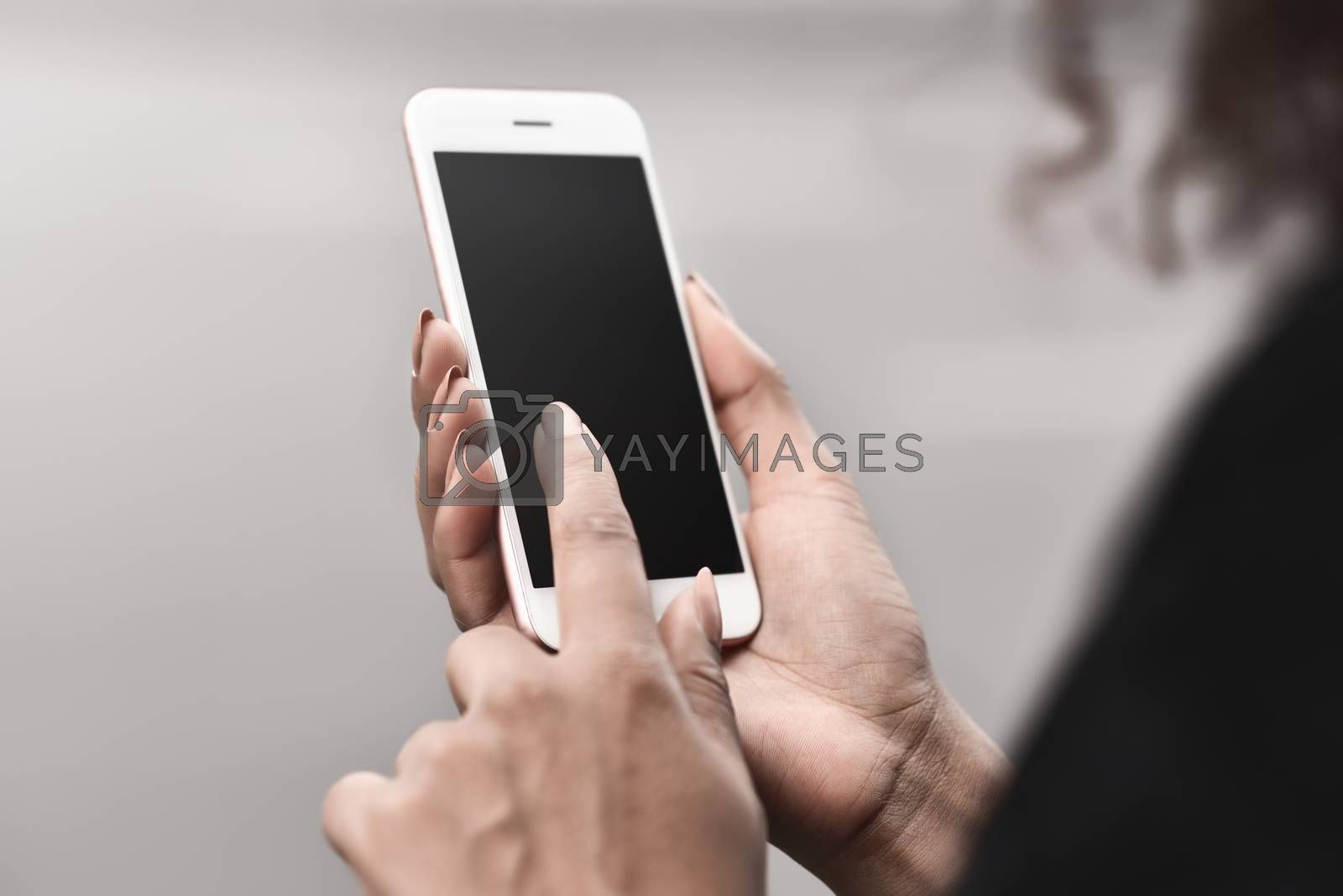 Cropped image of woman's hands holding smart phone with blank copy space screen for your text message or promotional content, female chatting in network on cell telephone.