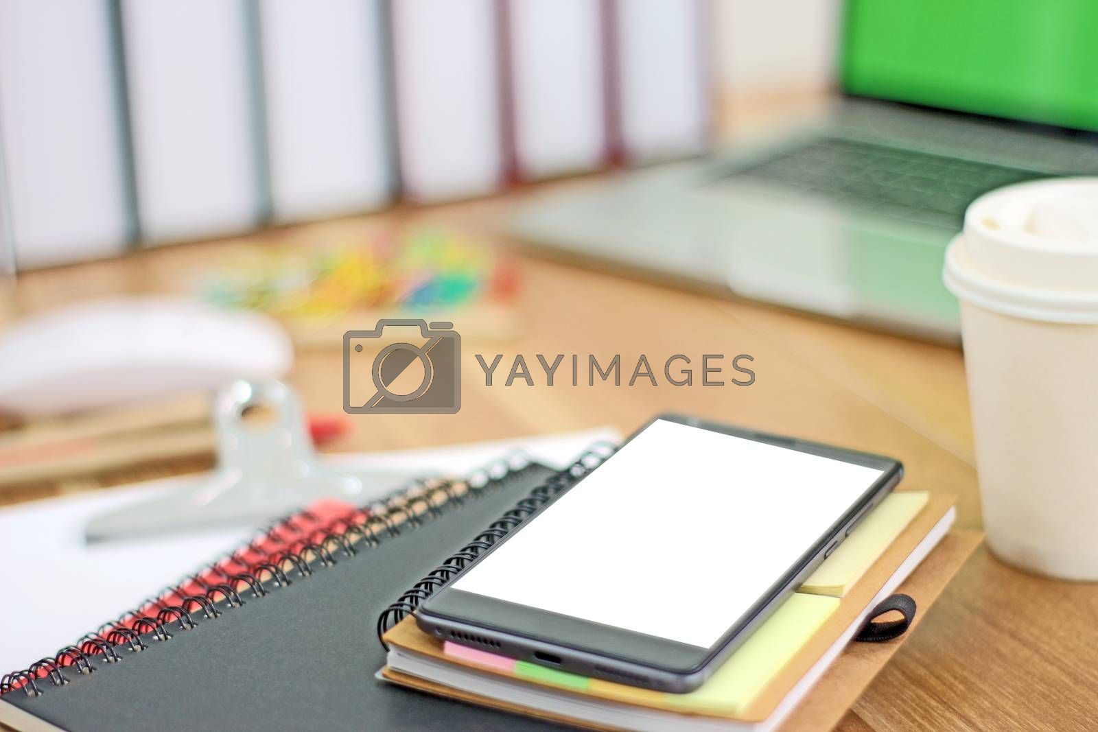 Workspace with mobile phone and office equipments on wood desk work background