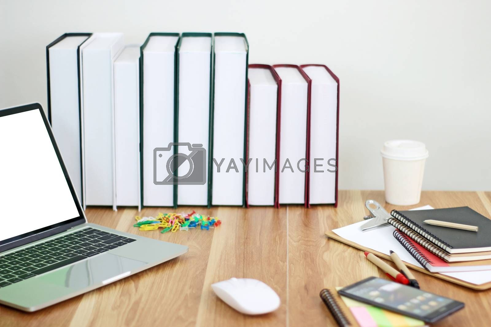 Workspace with office equipments on wood desk work background