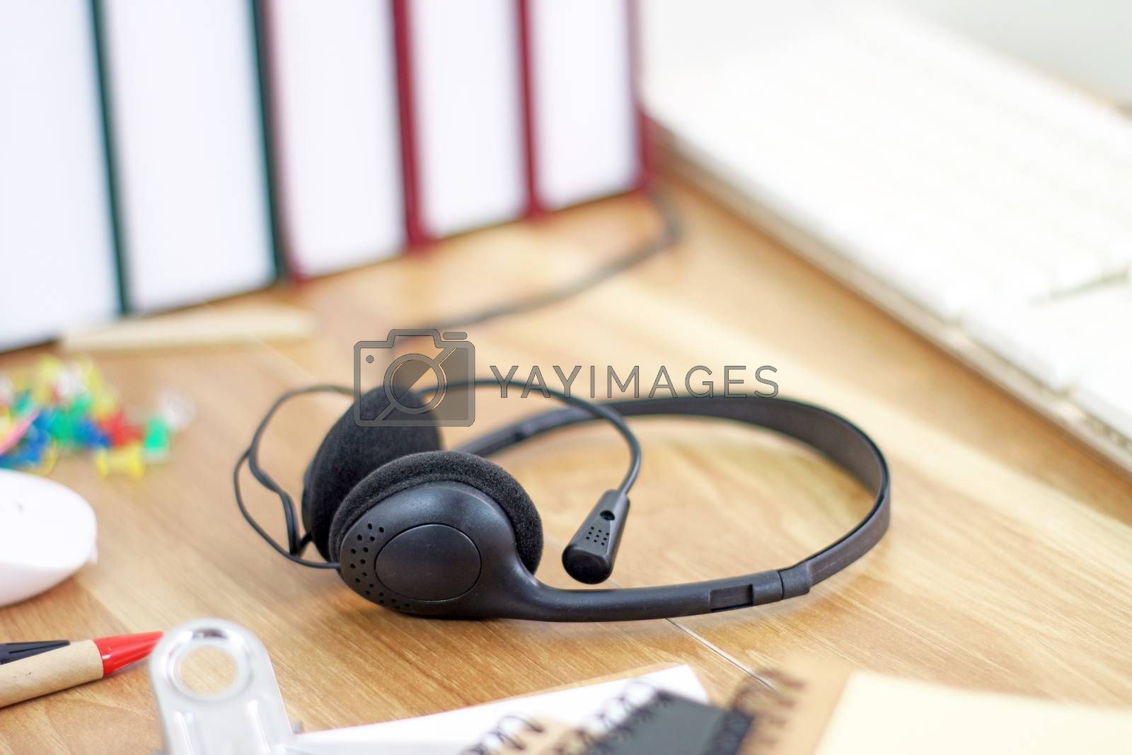 Workspace with headset and office equipments on wood desk work background