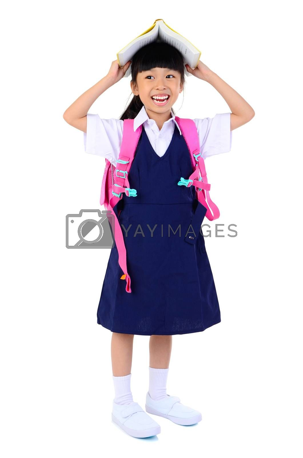 Portrait of Asian child in school uniform with school bag on and holding a book white background isolated.