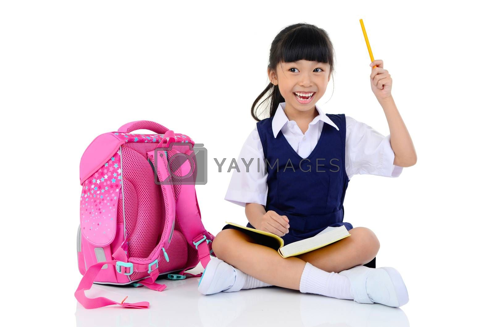 Happy little schoolgirl with books and bag,holding a pencil , isolated on white background