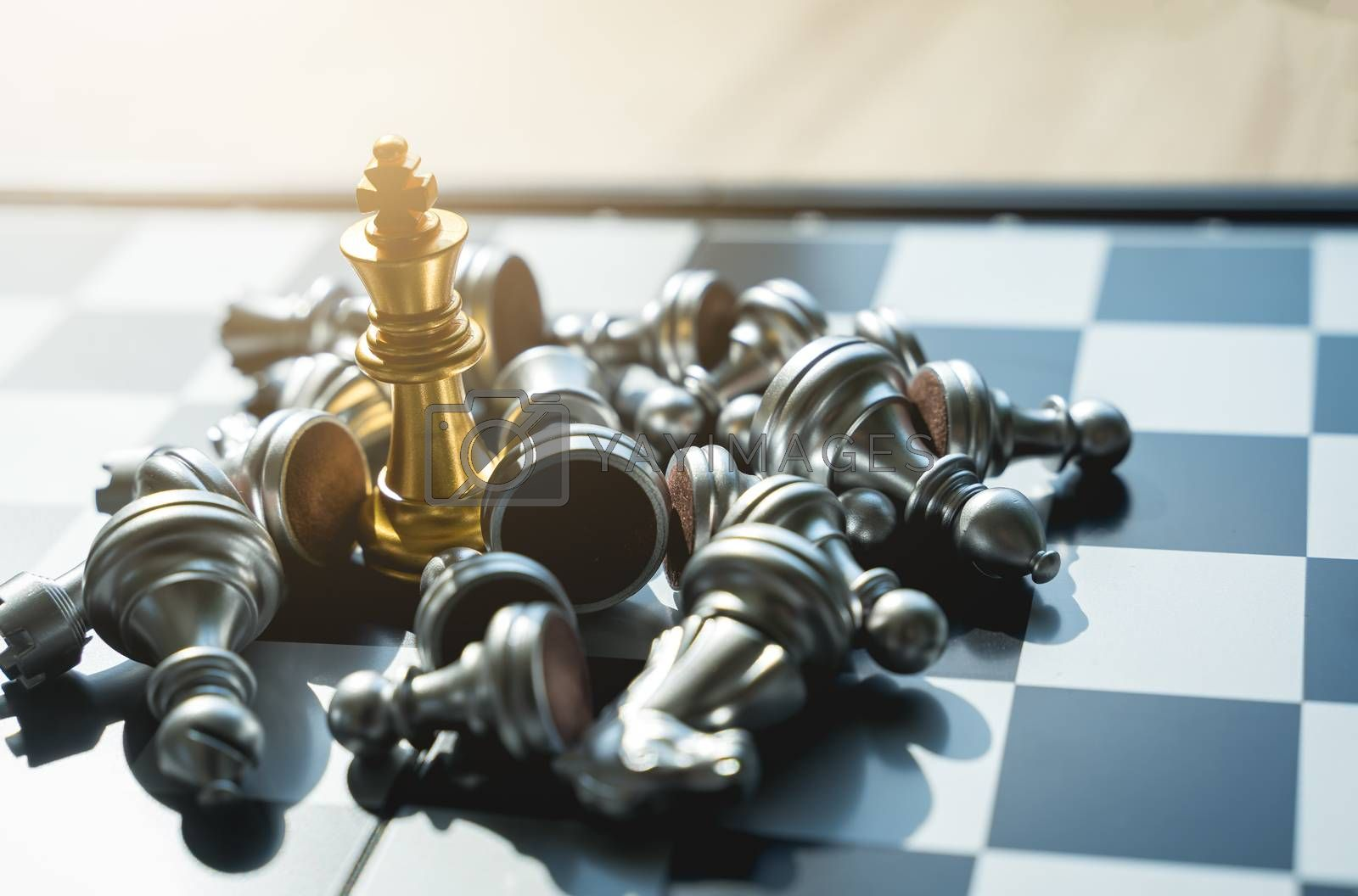 Golden King Chess wins in games with silver chess falling Defeat ed, in concept, business, victory, success and competition On the chess board with copy space selective focus at Golden King Chess