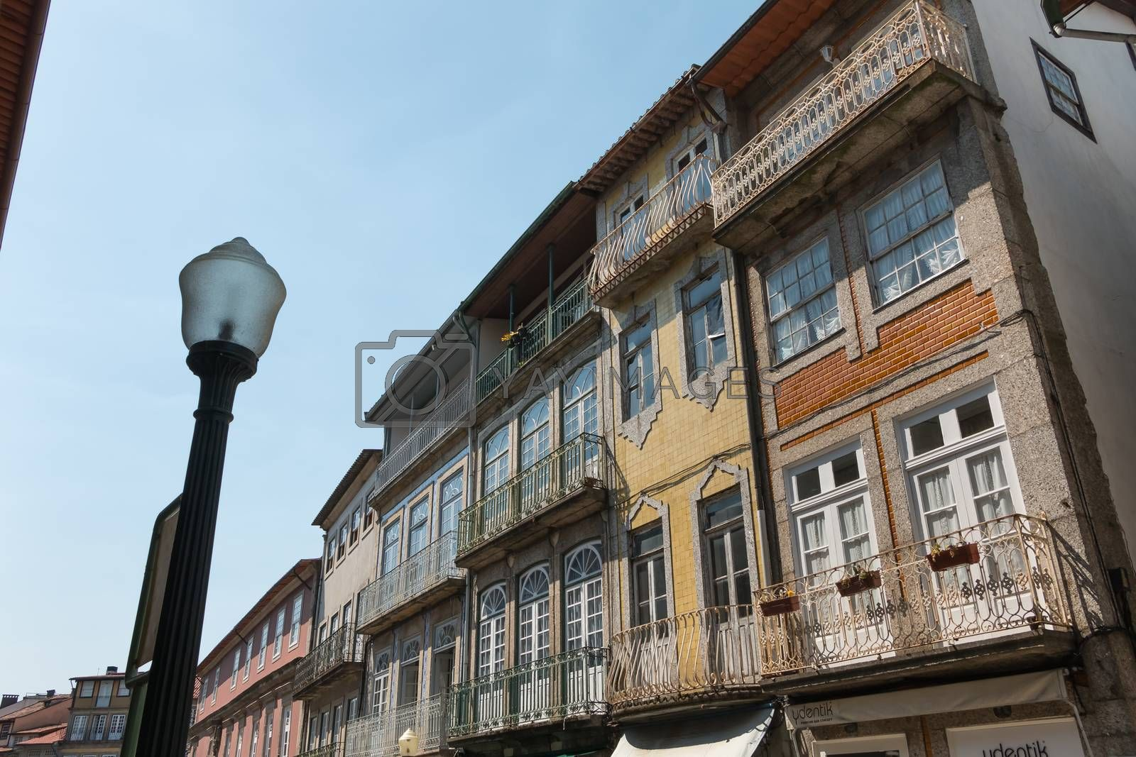 Guimaraes, Portugal - May 10, 2018: Architecture detail of houses typical of the small streets of the historic city center that tourists visit on a spring day