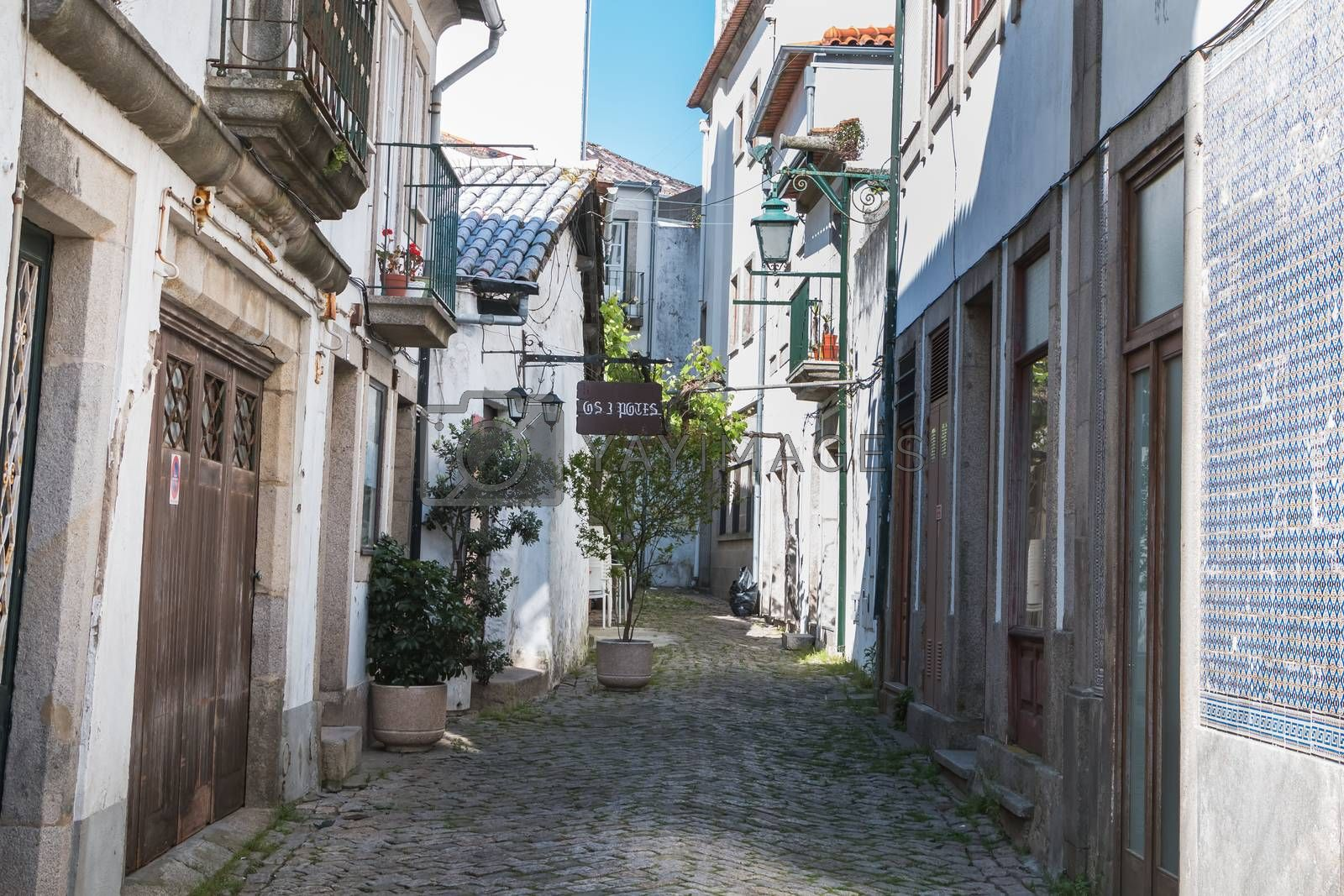 Viana Do Castelo, Portugal, Portugal - May 10, 2018: Architecture detail of typical houses and shops in the streets of the historic city center that tourists visit on a spring day