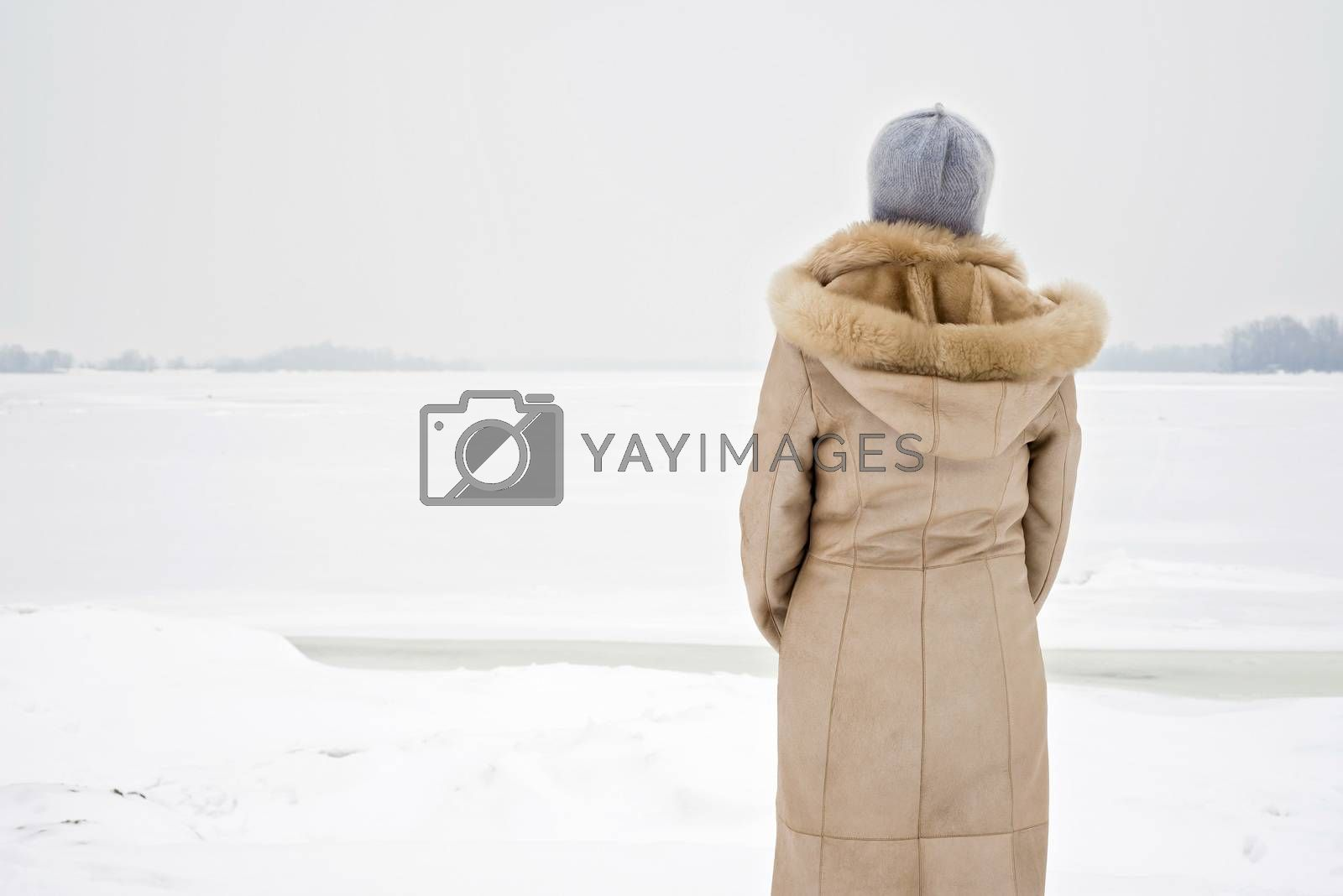 Woman Close to the Frozen River in Winter by MaxalTamor