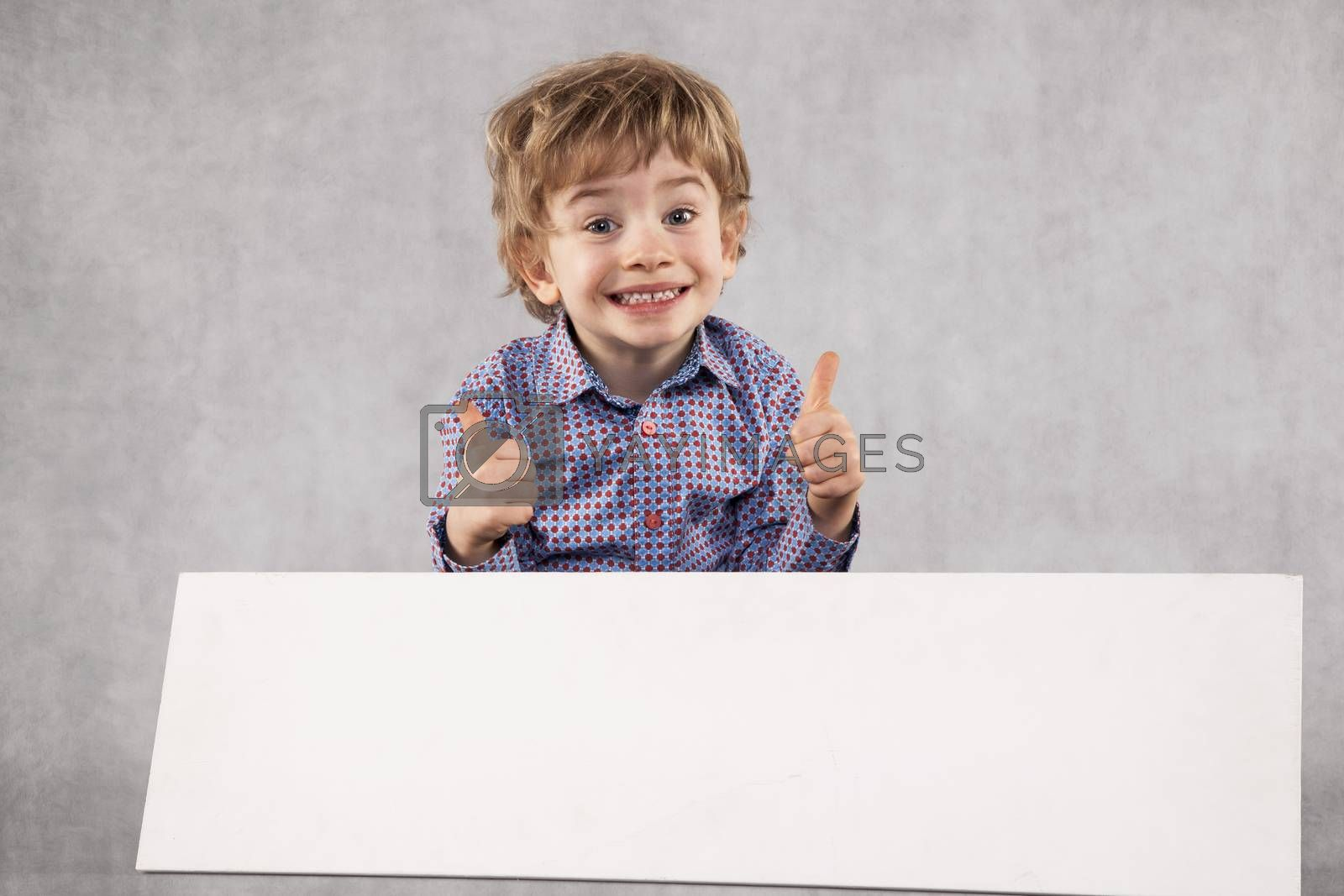 young happy businessman recommends a place for advertising, copy space
