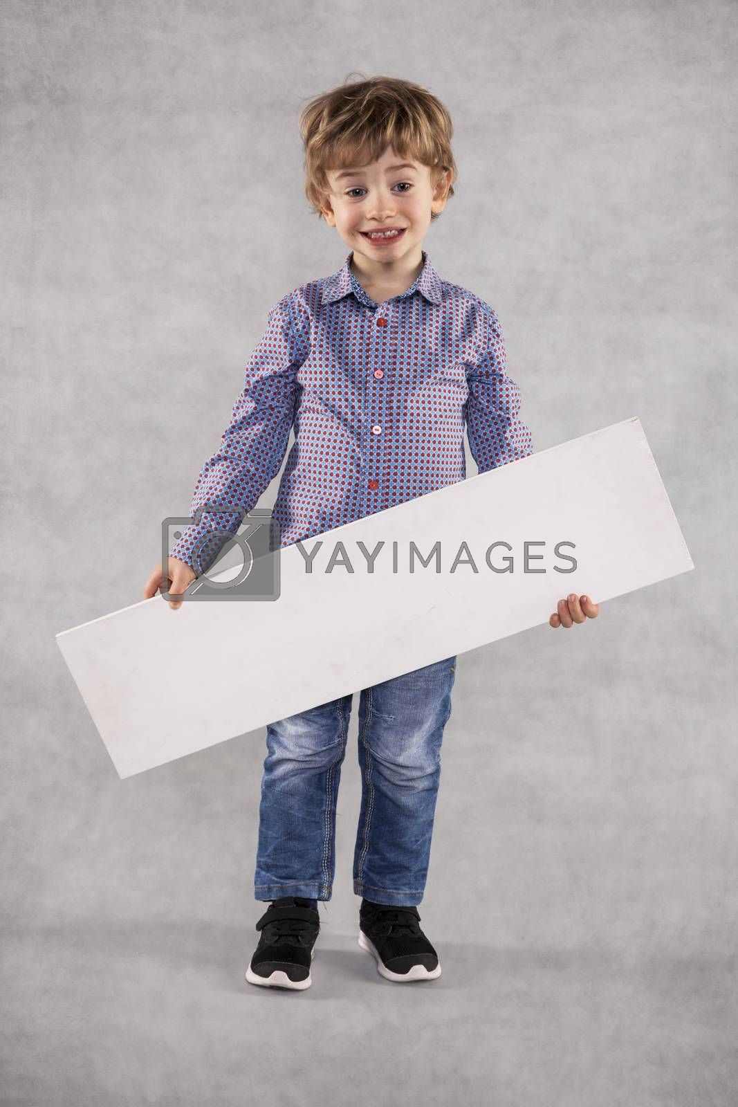 young businessman holding a board with copy space, happiness