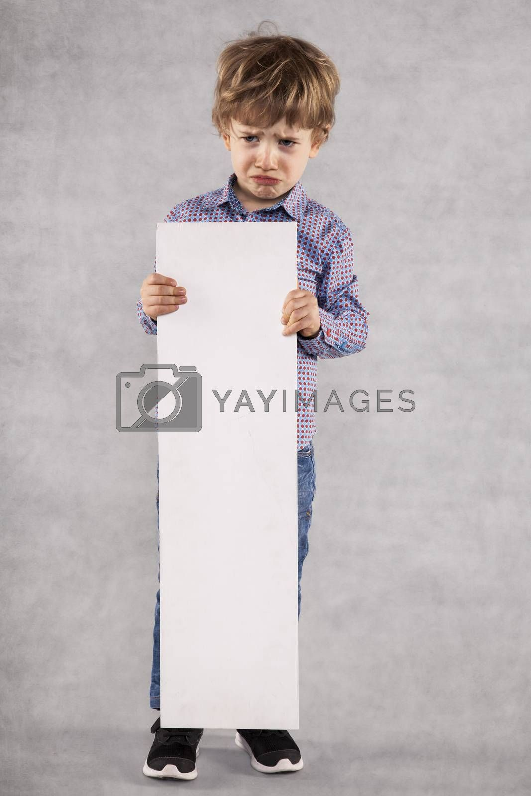 young businessman holds an advertising space for sale, grimace on the face