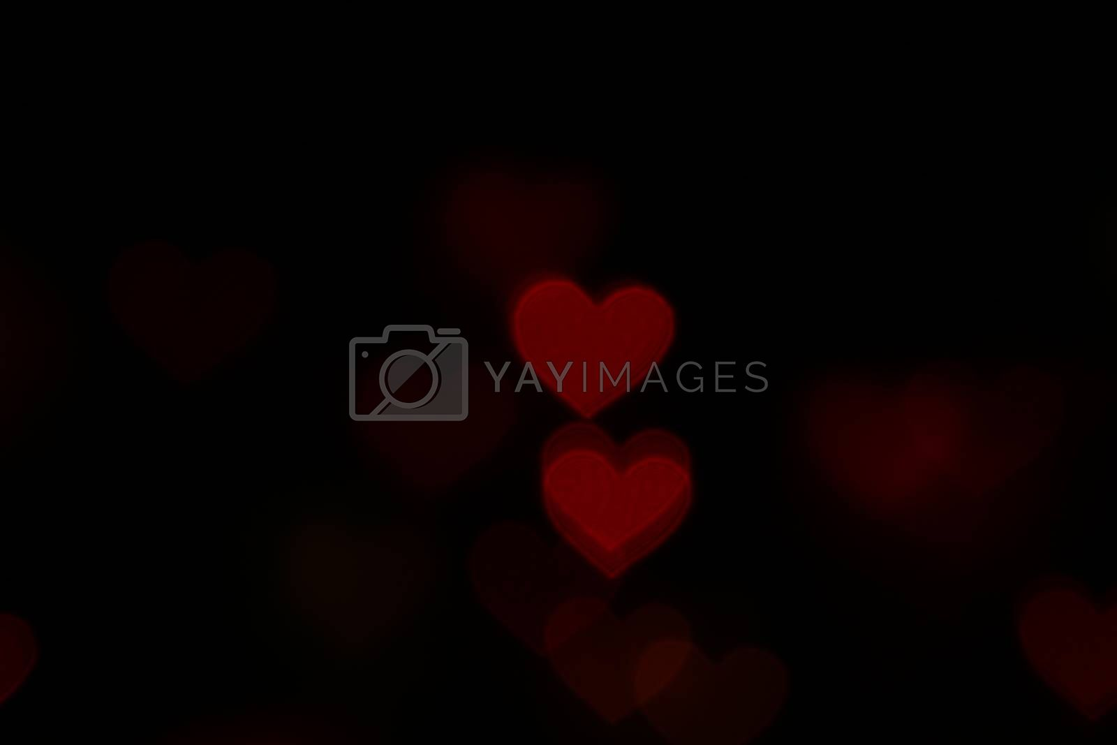 Valentine Red heart-shaped on black background Colorful lighting bokeh for decoration at night backdrop wallpaper blurred valentine, Love background, Lighting heart shaped soft night abstract