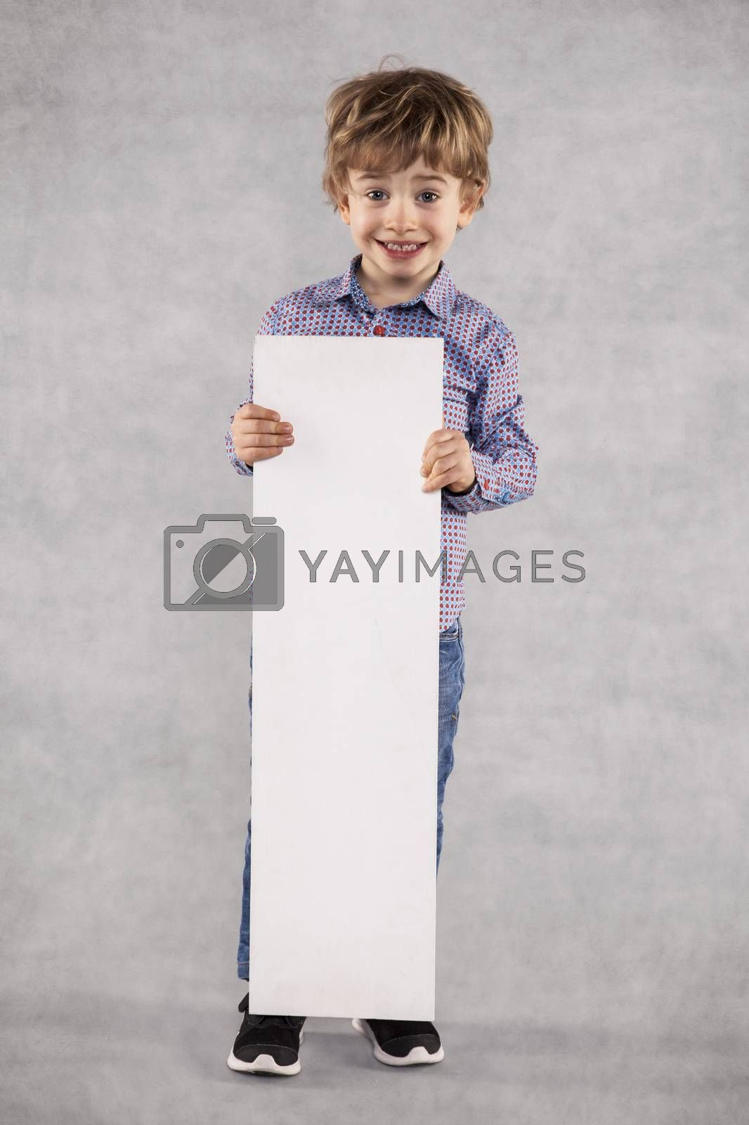 young businessman holds an advertising space for sale, copy space