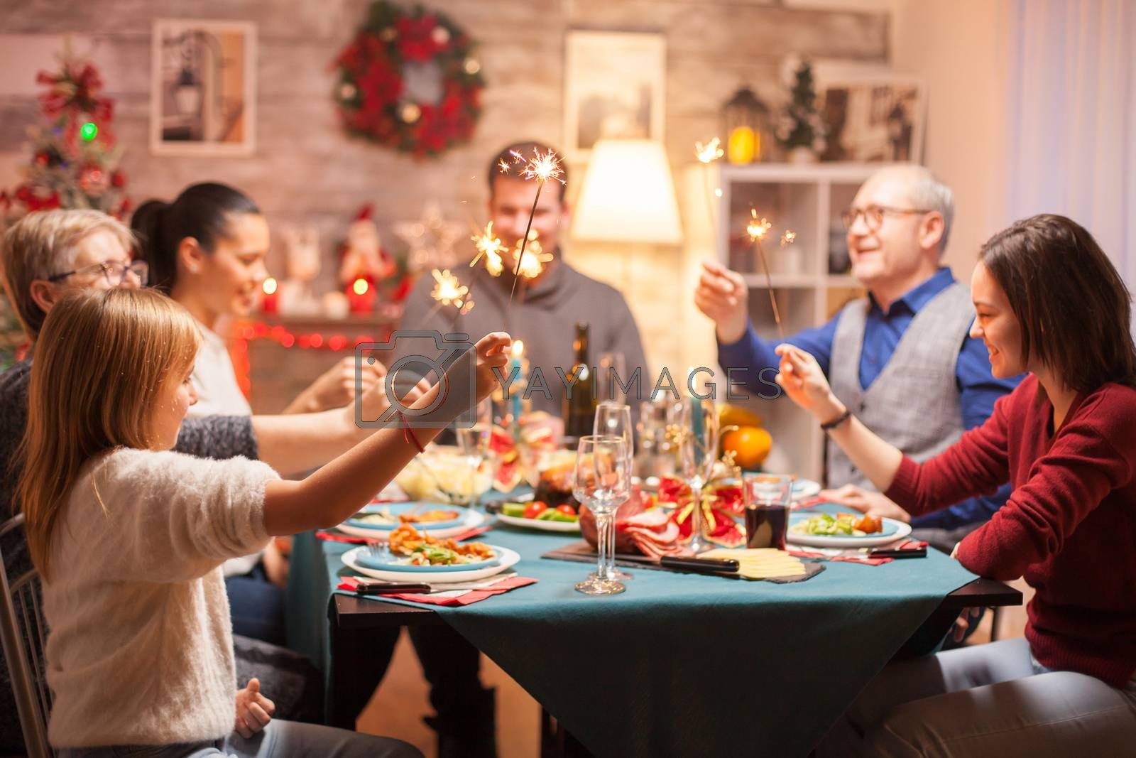 Cheerful senior man at christmas family dinner by DCStudio
