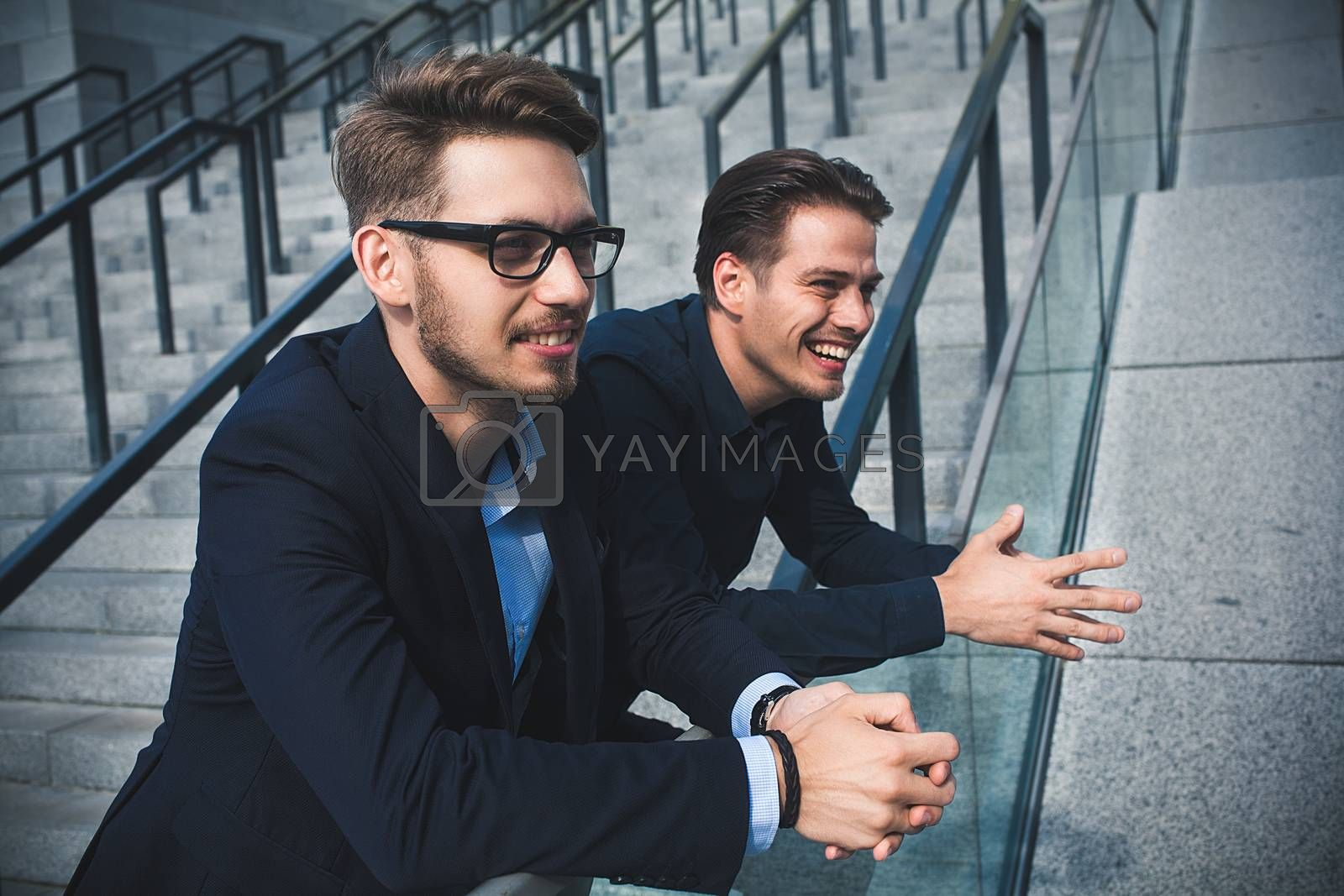Two awesome businessman have a rest between a work. Speak easy
