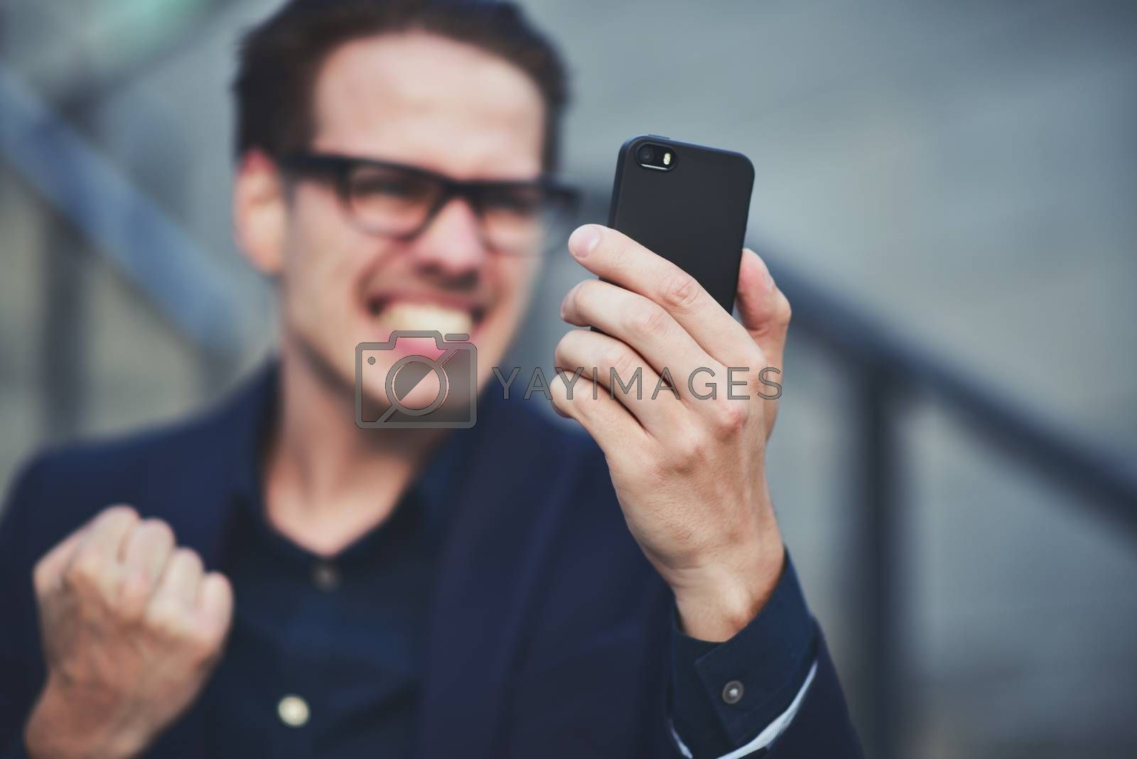 Happy caucasian businessman in glasses dressed at classic wear standing at the street.