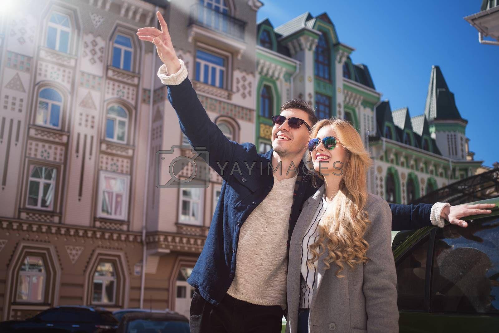 Couple walks in the beautiful city,bright day