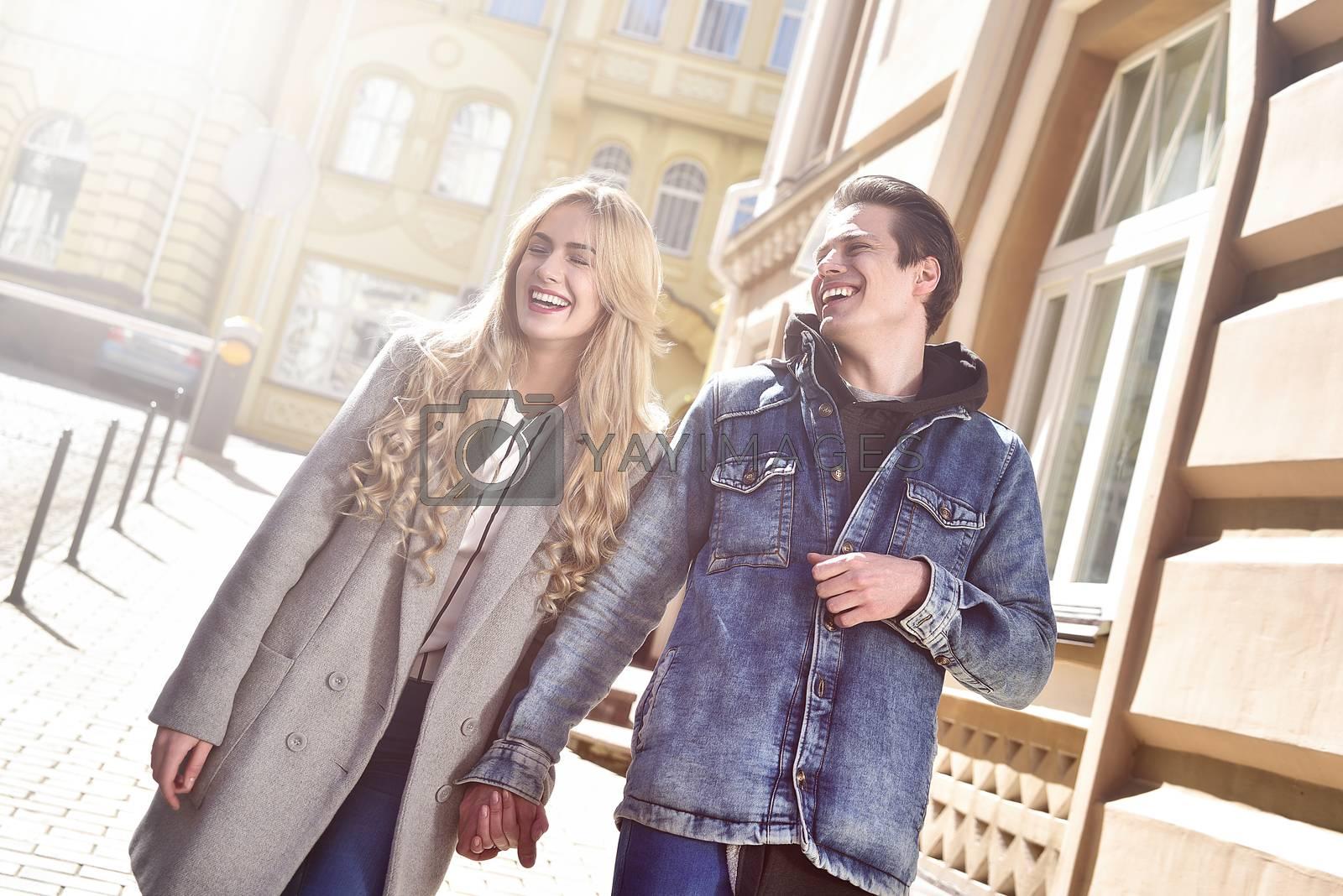 Young laughing couple enjoying sunny mood and having fun