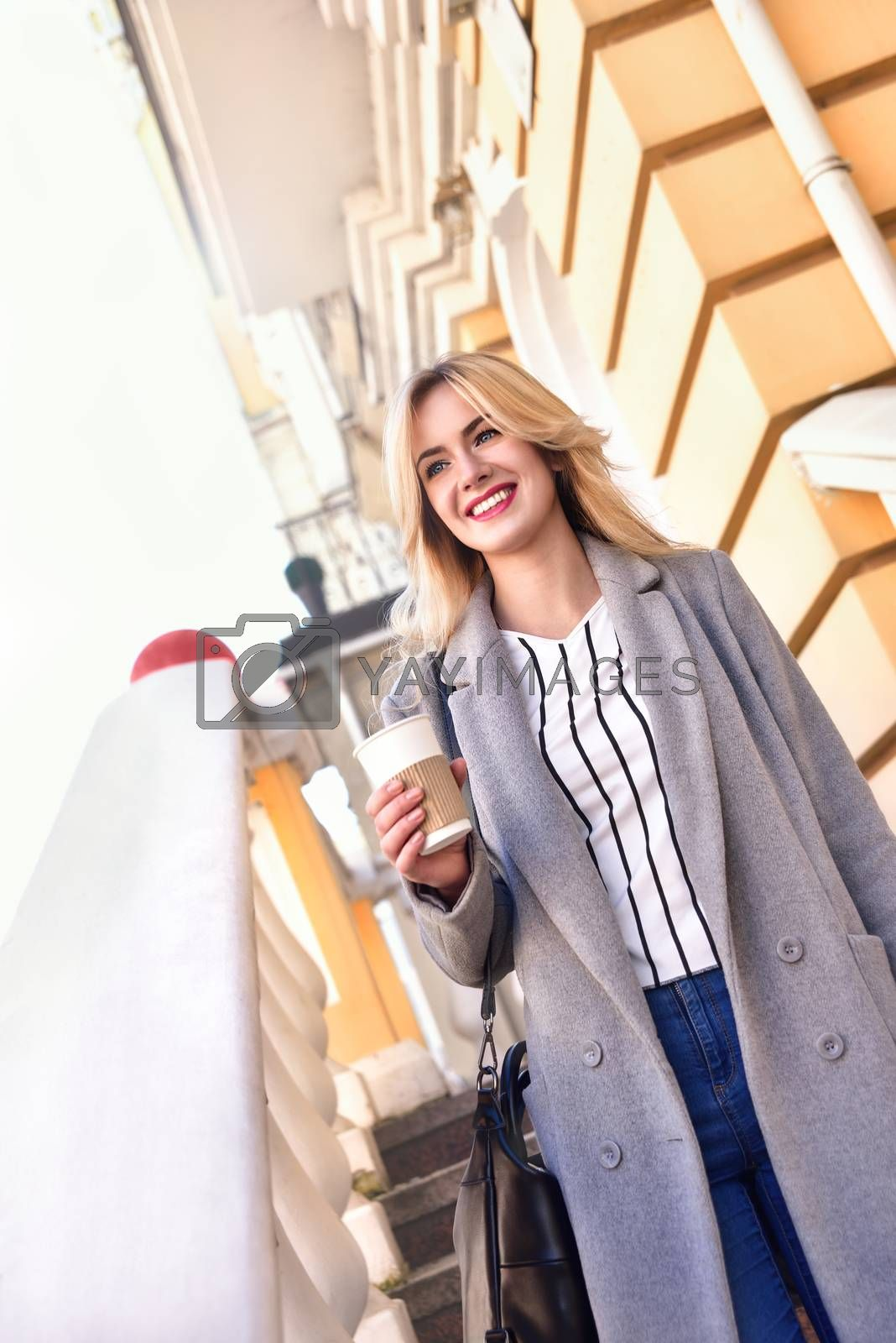 Business . woman with coffee smiling on the street
