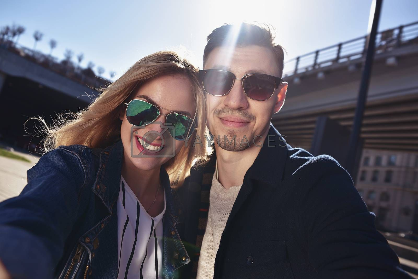 Happy young couple in love takes a selfie portrait
