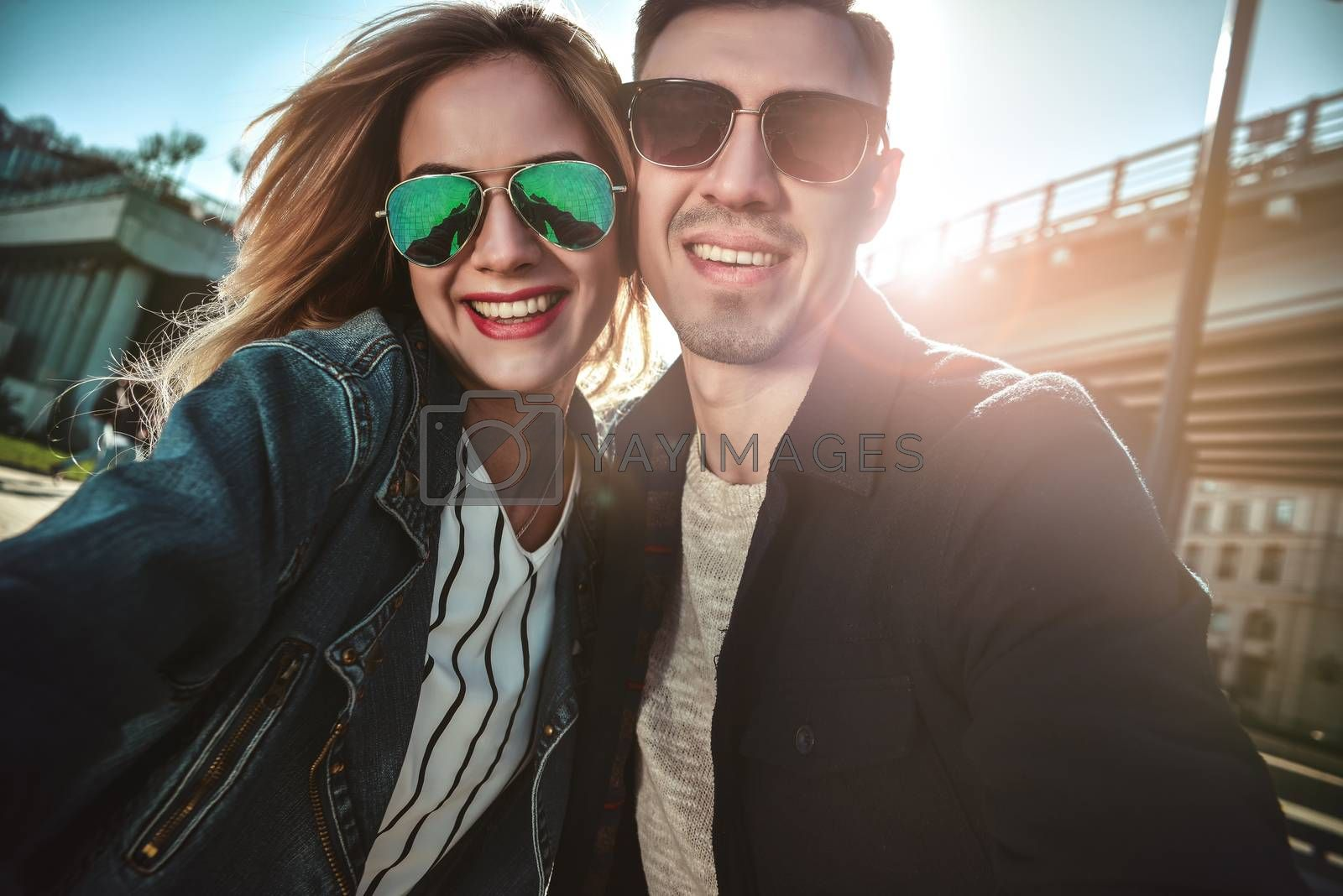 Happy young couple in love takes selfie portrait.