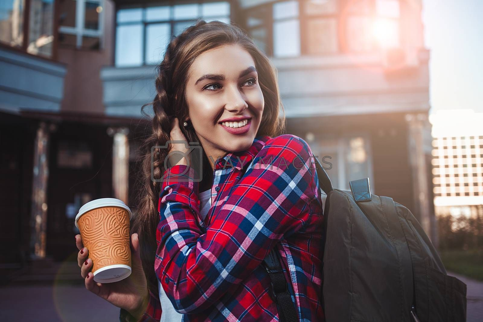 Awesome girl in urban style walk in city with coffee.