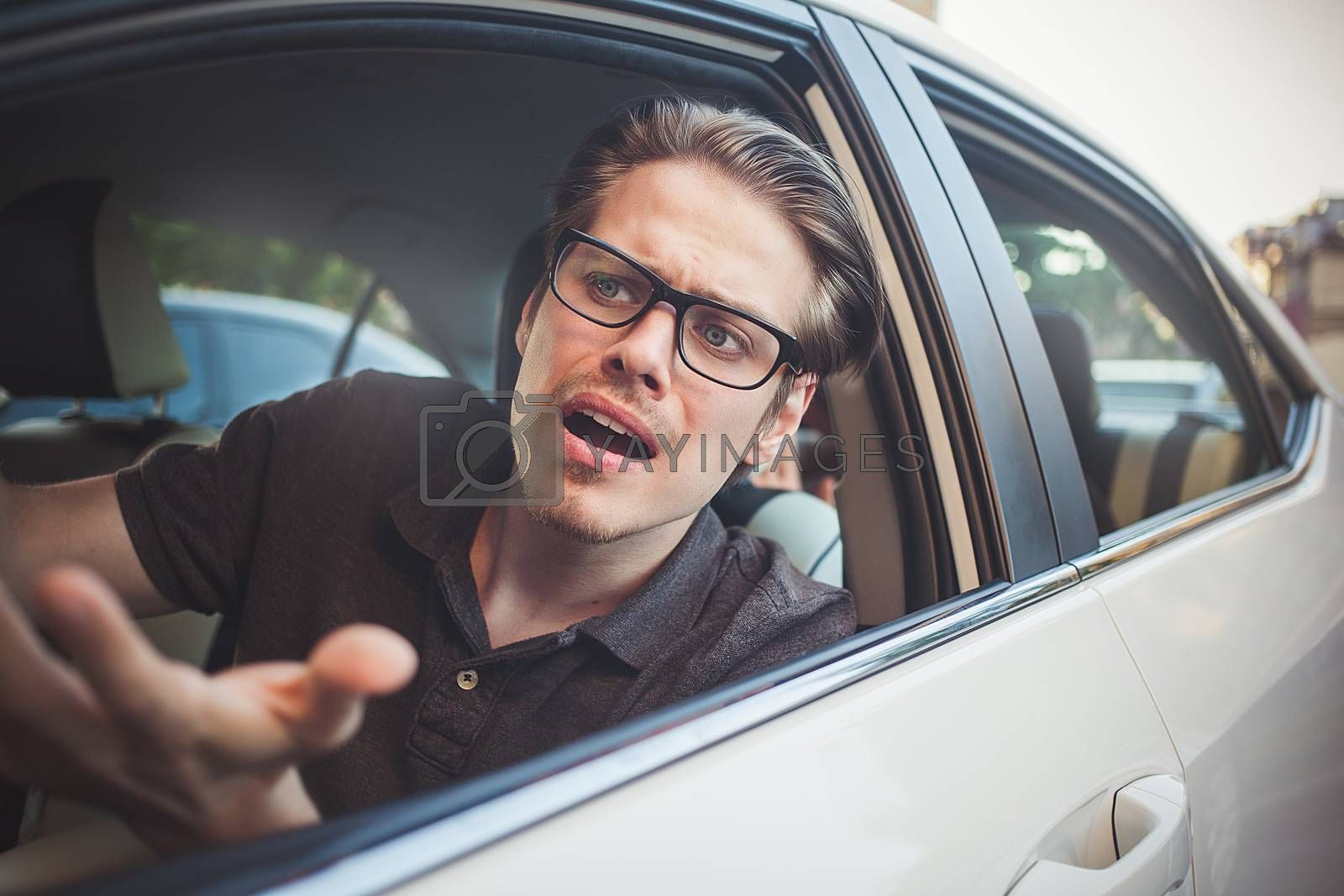 Accident. Young caucasian man driving a car shocked about to have traffic accident