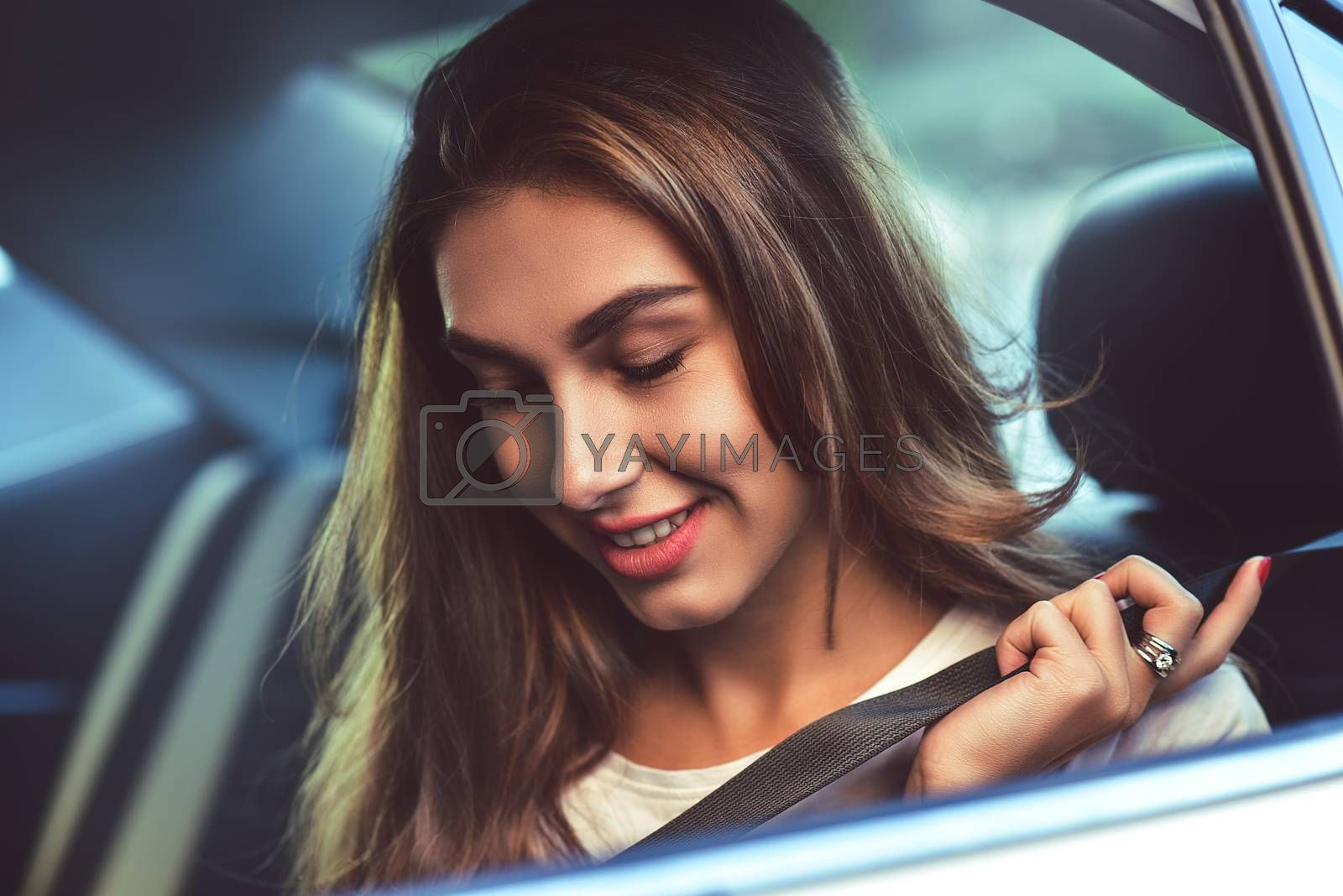 Attractive woman in car by Nickstock