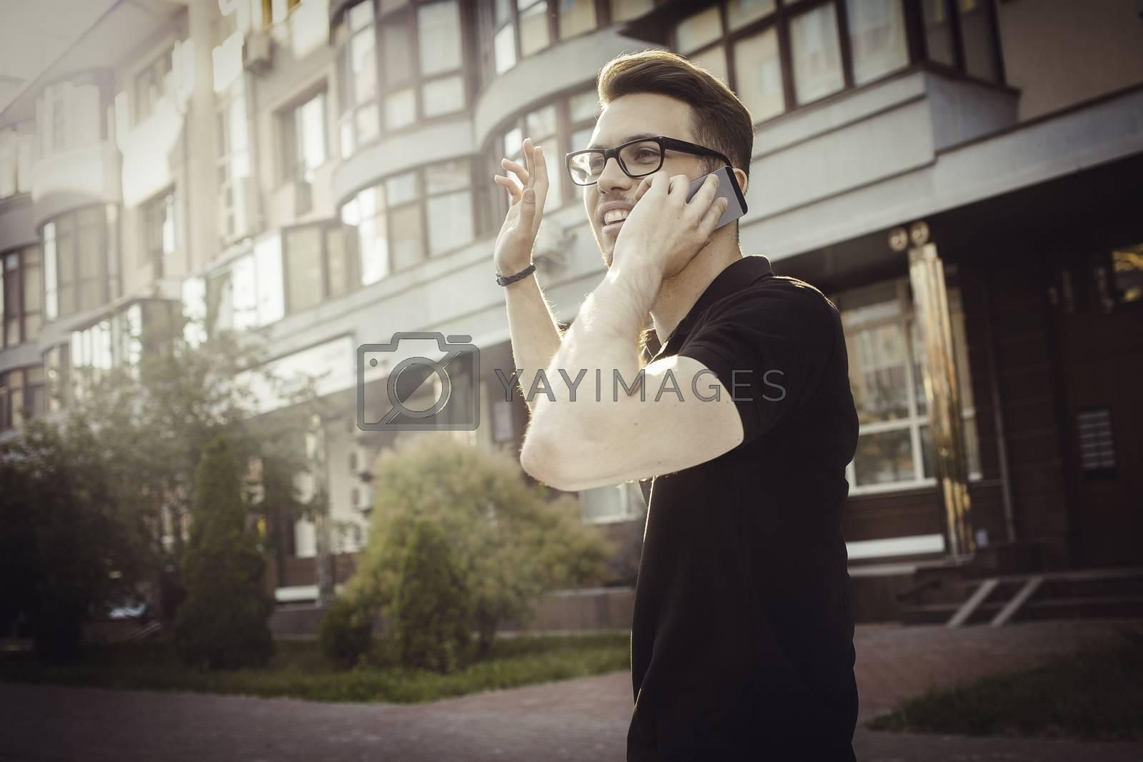 Cheerful young man waving his hand to say hello