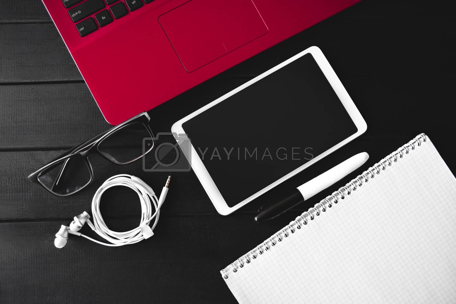 Home work concept, Tablet Pc, notepad and Laptop on wooden background, planning personal income. preparation to work. free copyspace