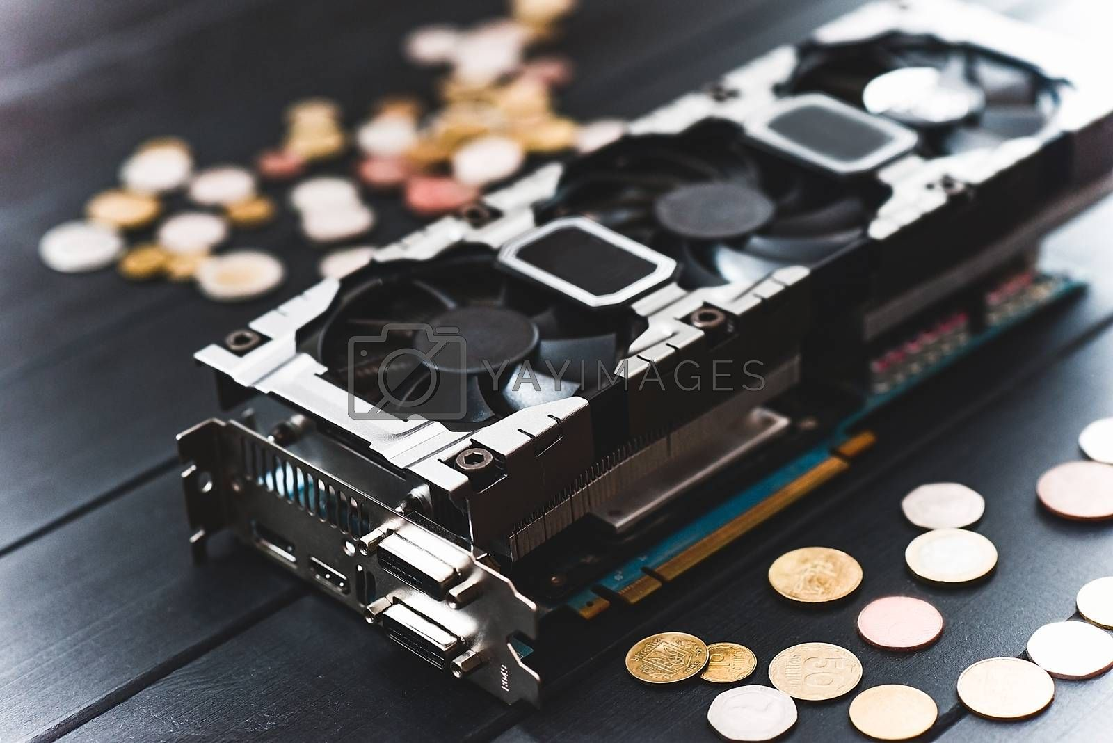 Cryptocurrency mining concept with bitcoins on a computer videocard. free copyspace