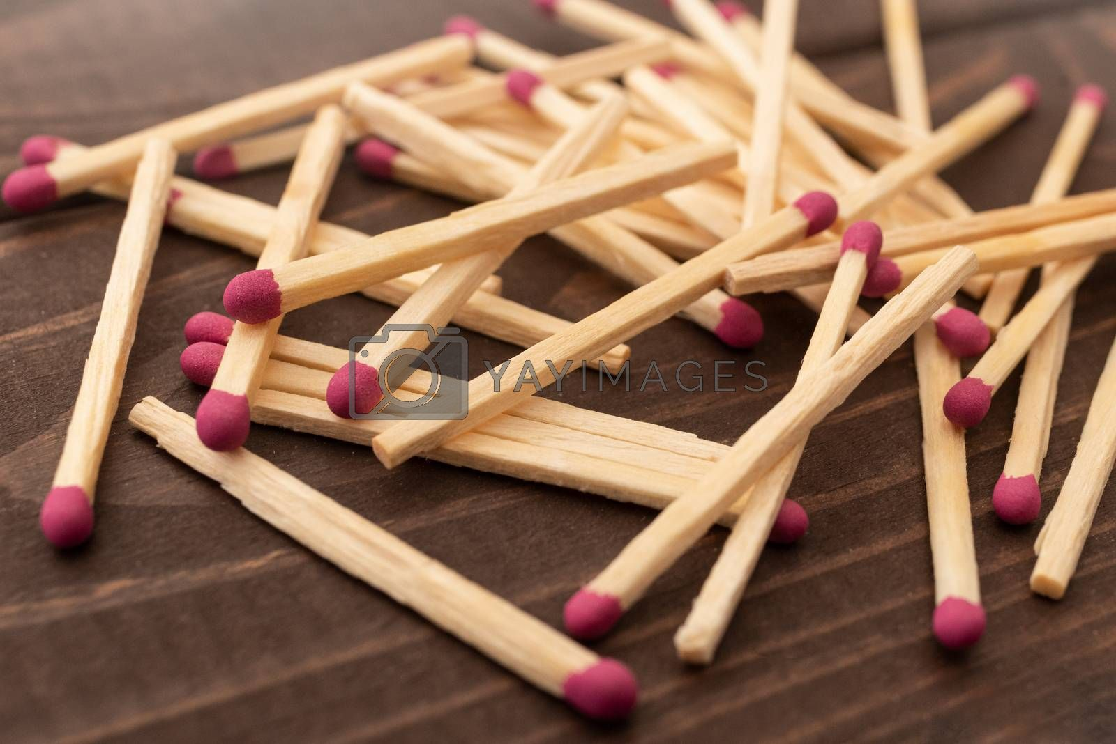 Matches on a white isolated background. Matches on a wooden background. Matches
