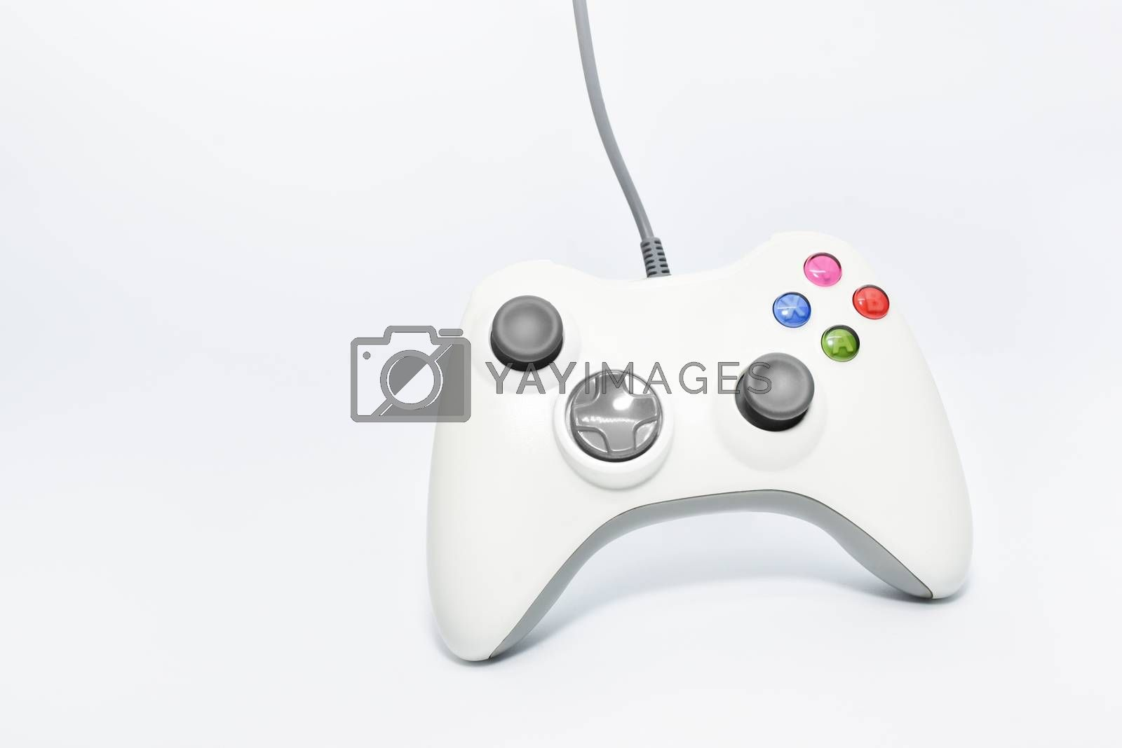 Gaming console game pad isolated on white background. Video gaming concept. Top view cut out composition.