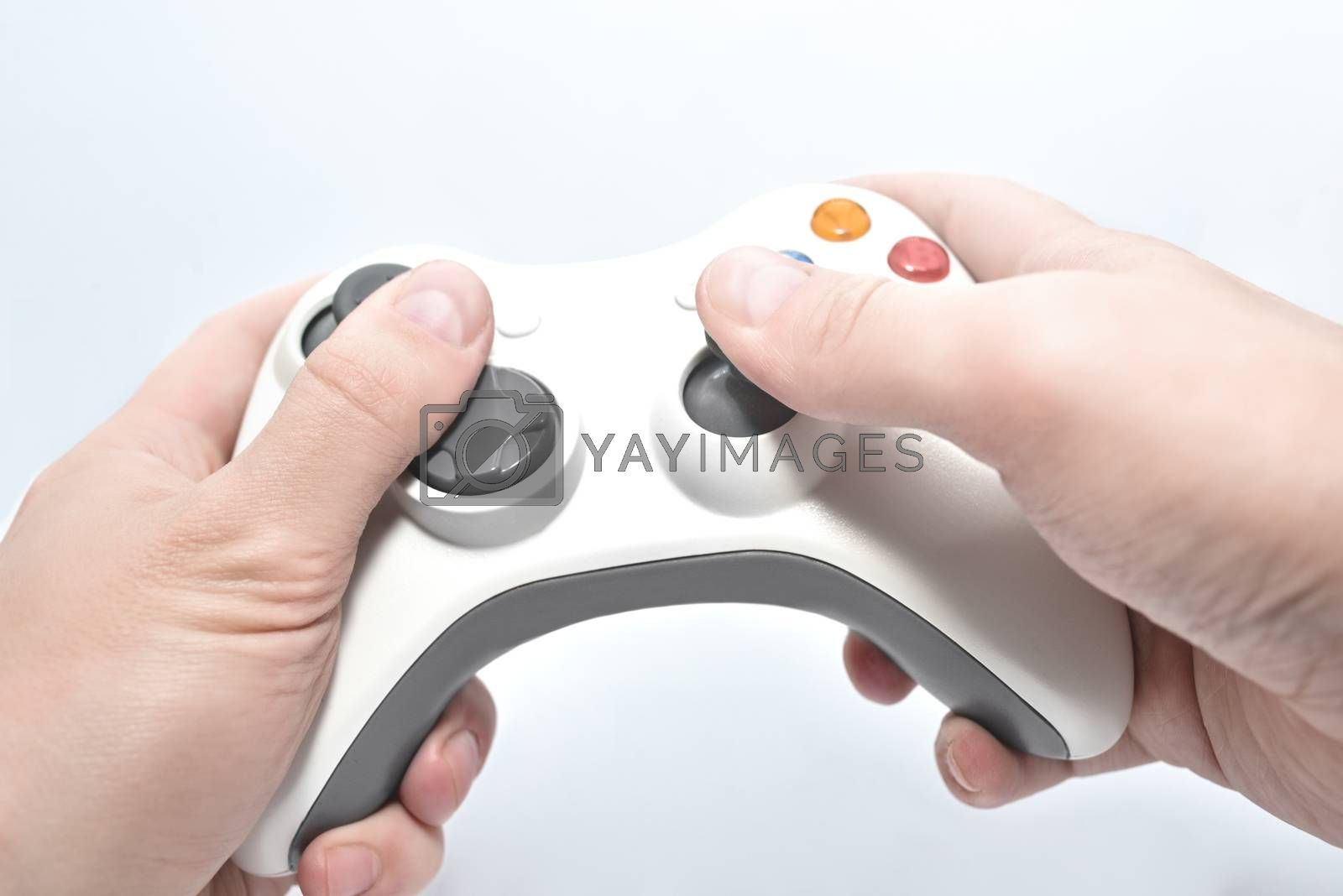 joystick gamepad in the player's hands isolated on white background. entertainment concept by Nickstock