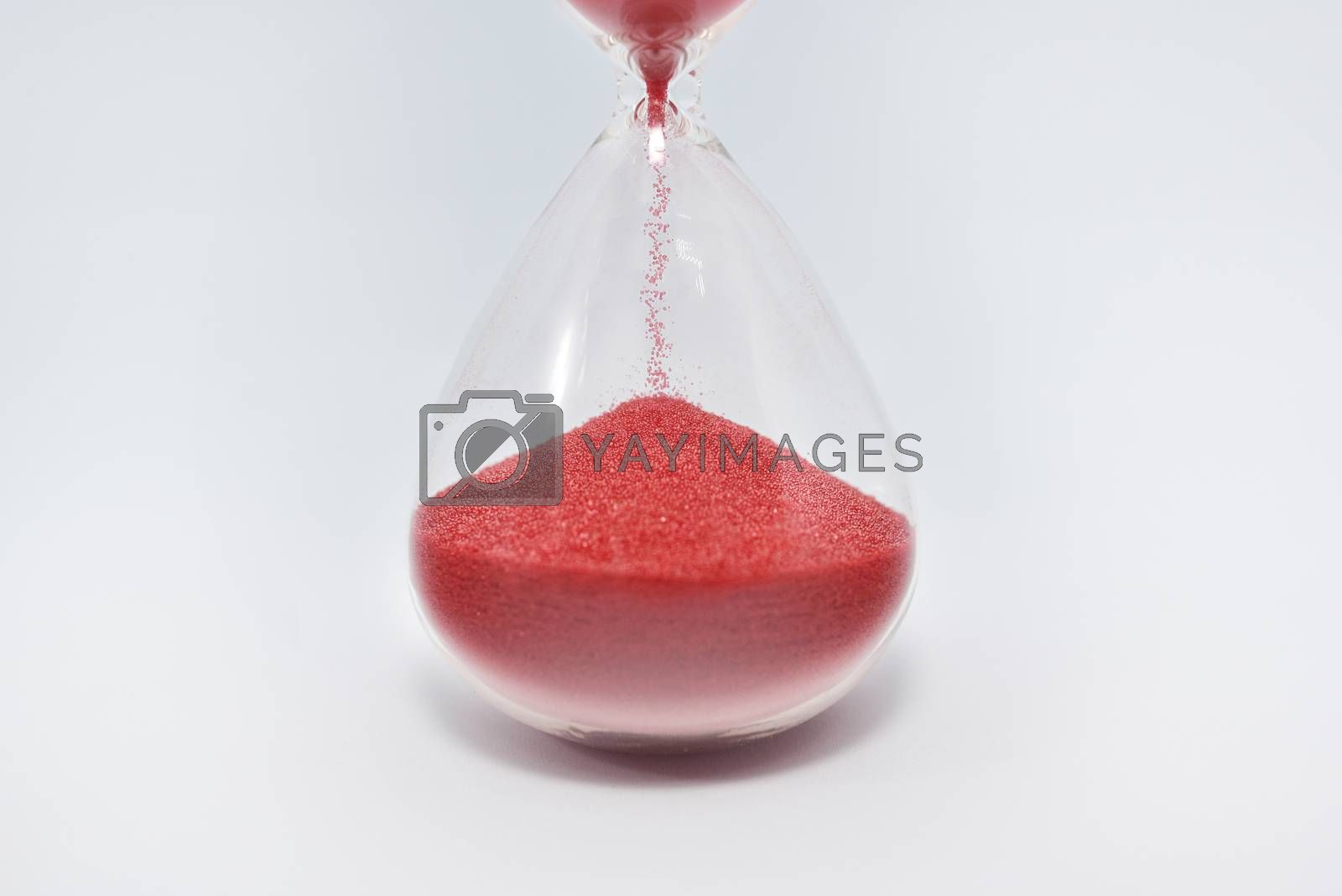 Hourglass sandglass clock isolated on white background. close up view. close up by Nickstock