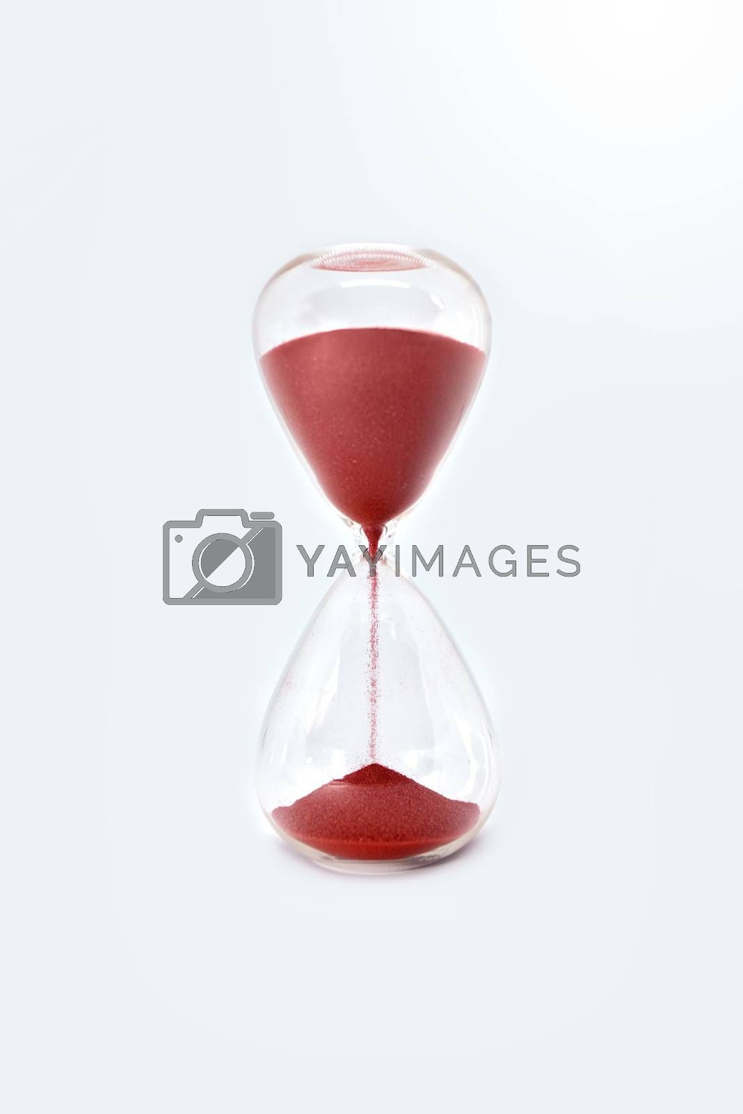 Hourglass clock isolated on white background