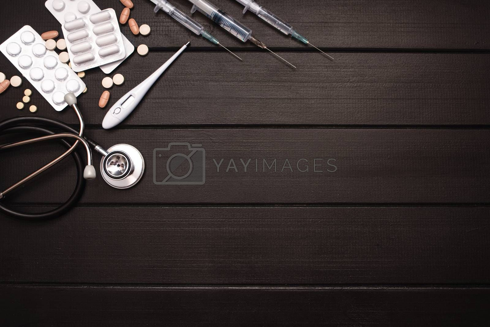 Medical Tools, Syringe and Colorful Drugs and Capsules Medicine Concept, Brown Wood Background, Front View, Close Up, Isolated